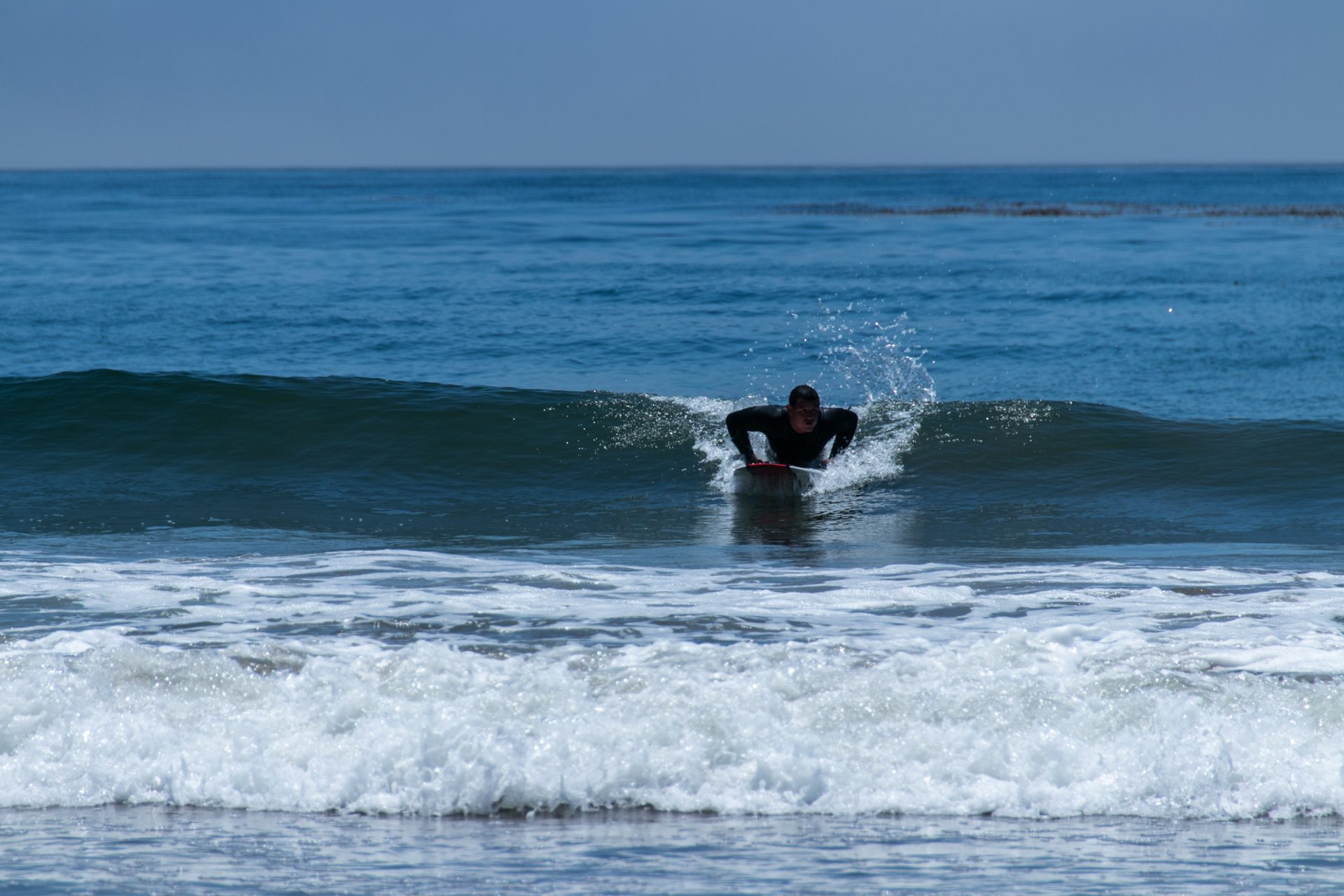 Surfer Belly Boarding On Small Waves