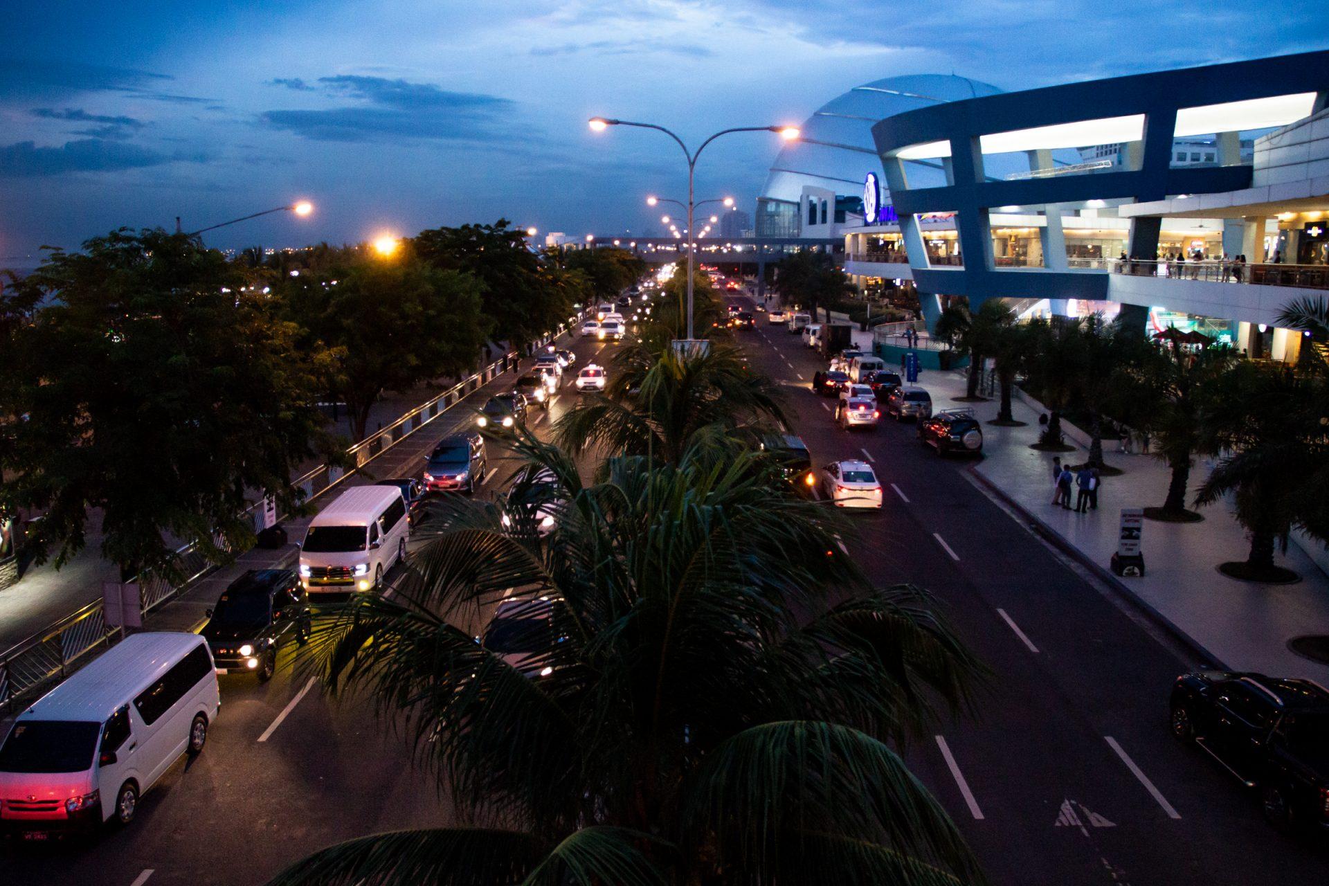 Traffic In Divided Highway In Manila At Dusk