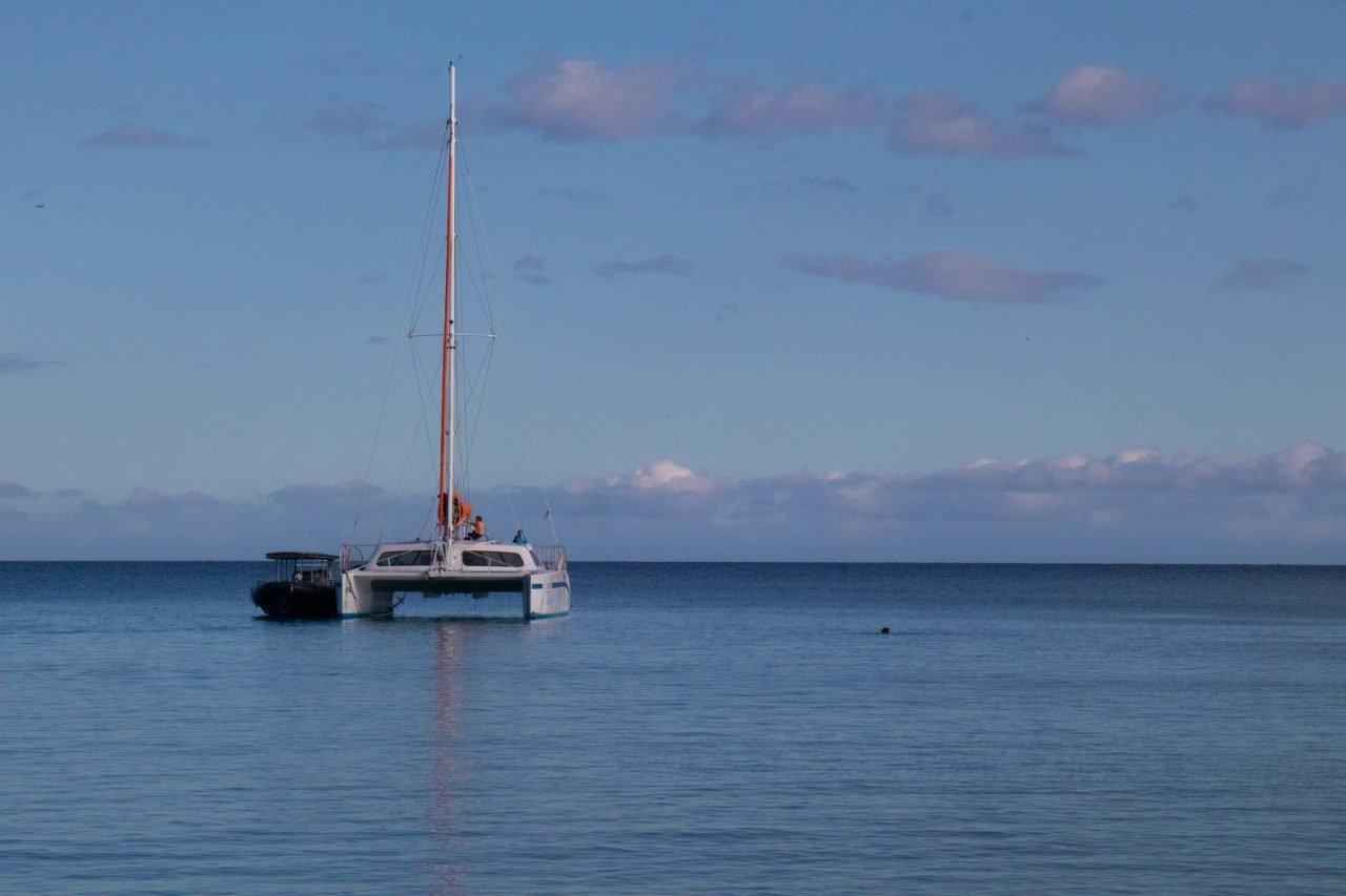 Sail Catamaran On Still Water