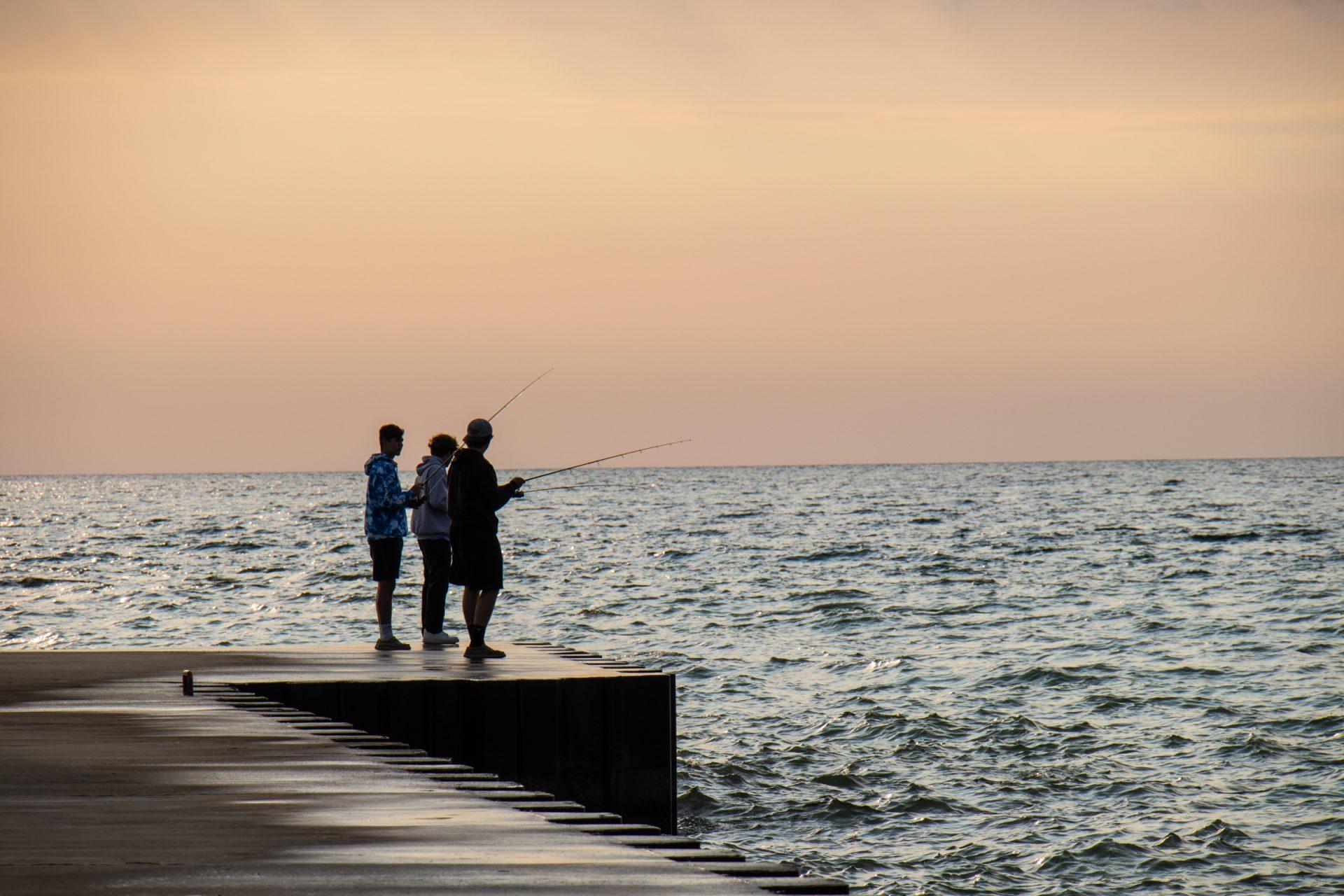 Three Men Fishing On Dock
