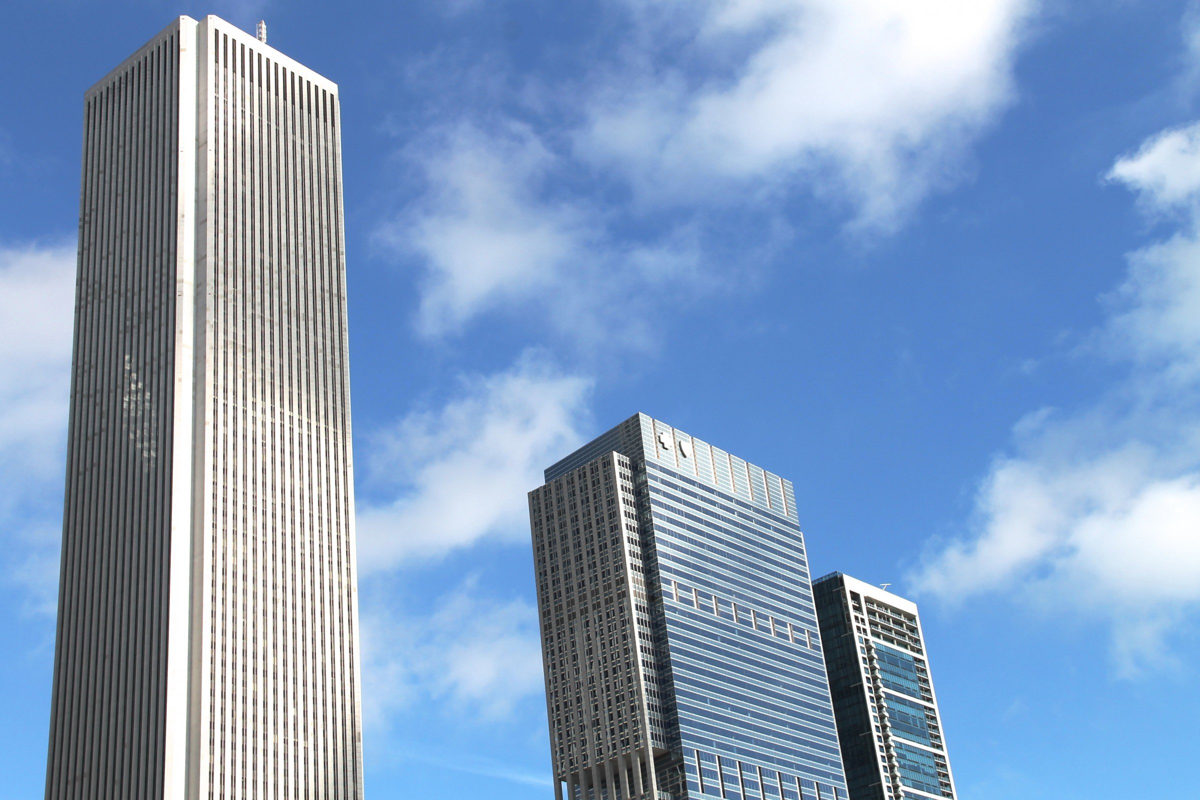 Free Stock Photo of 3 Tall Buildings in Sky with Clouds