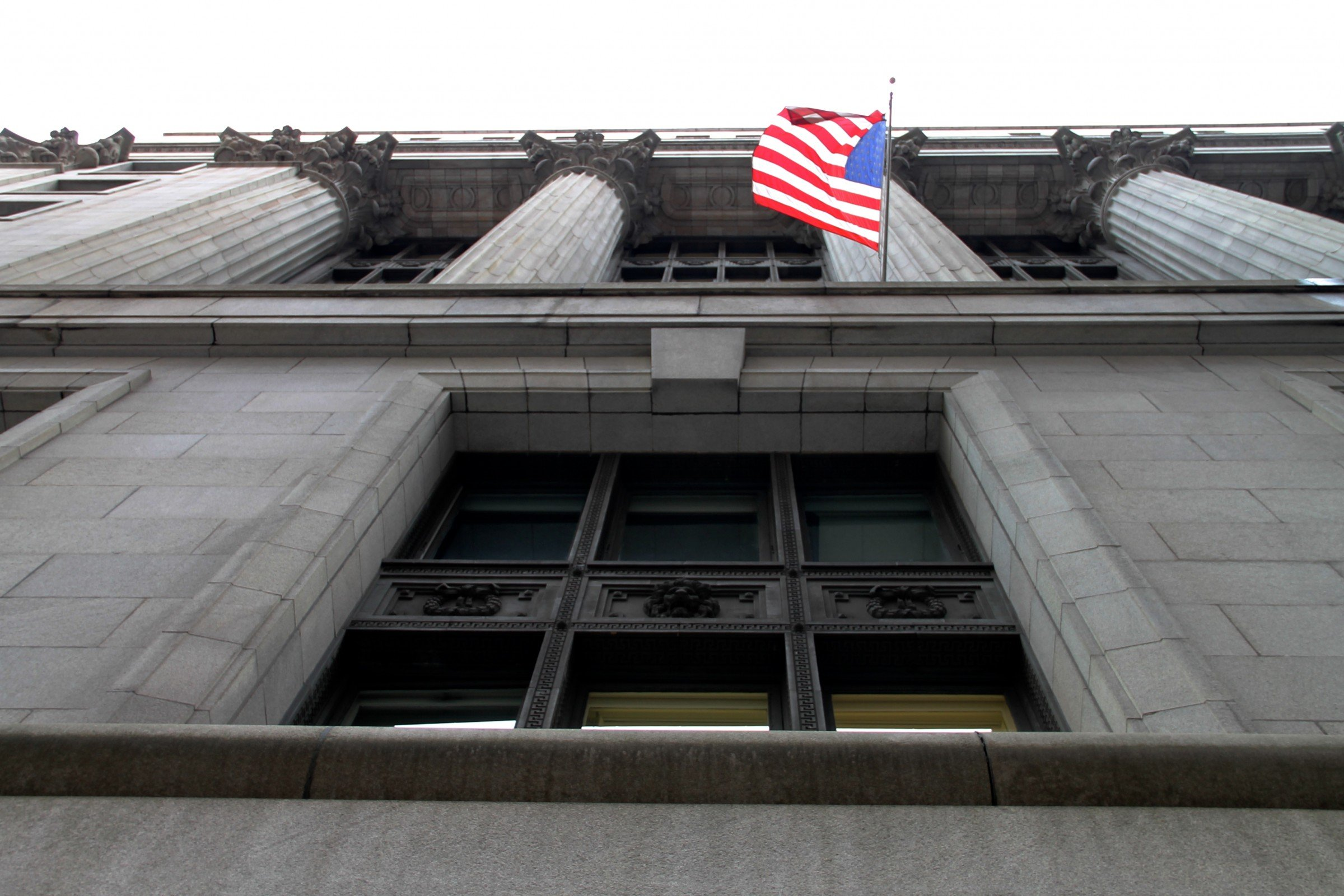 American Flag on Side of Building with Columns