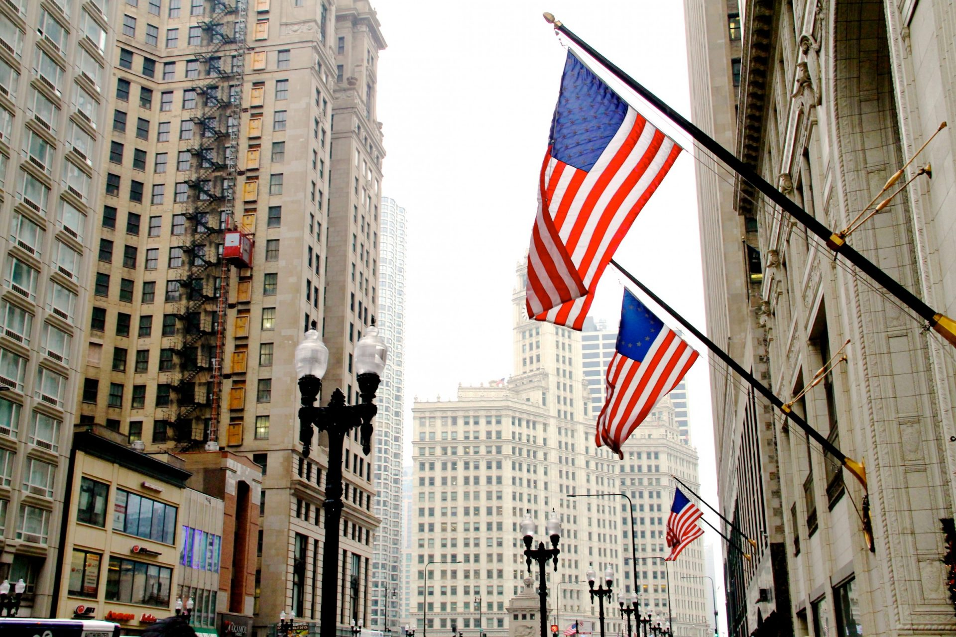 American Flags on Side of Building in City