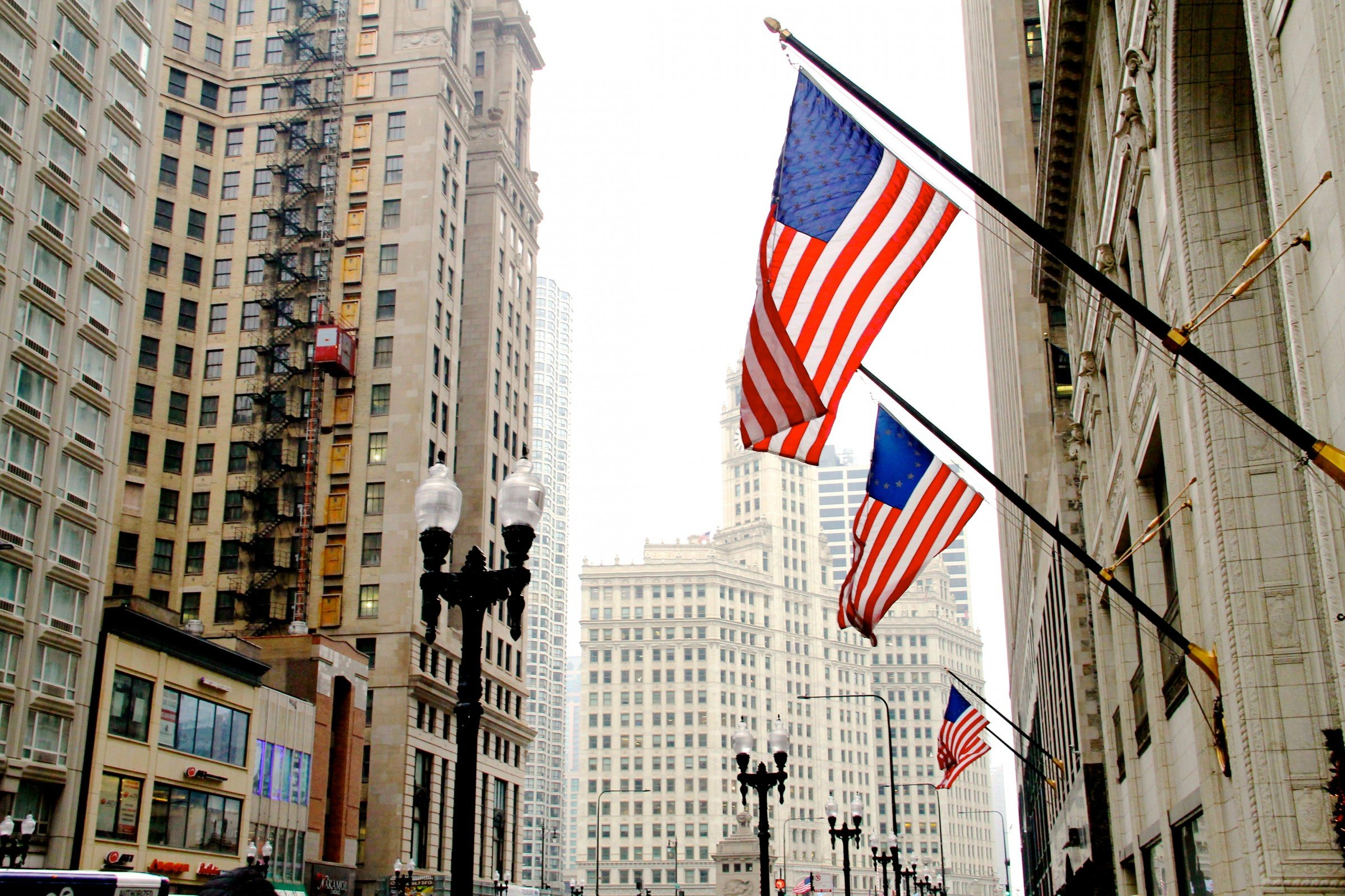 city building side. American Flags On Side Of Building In City Free Stock Photo