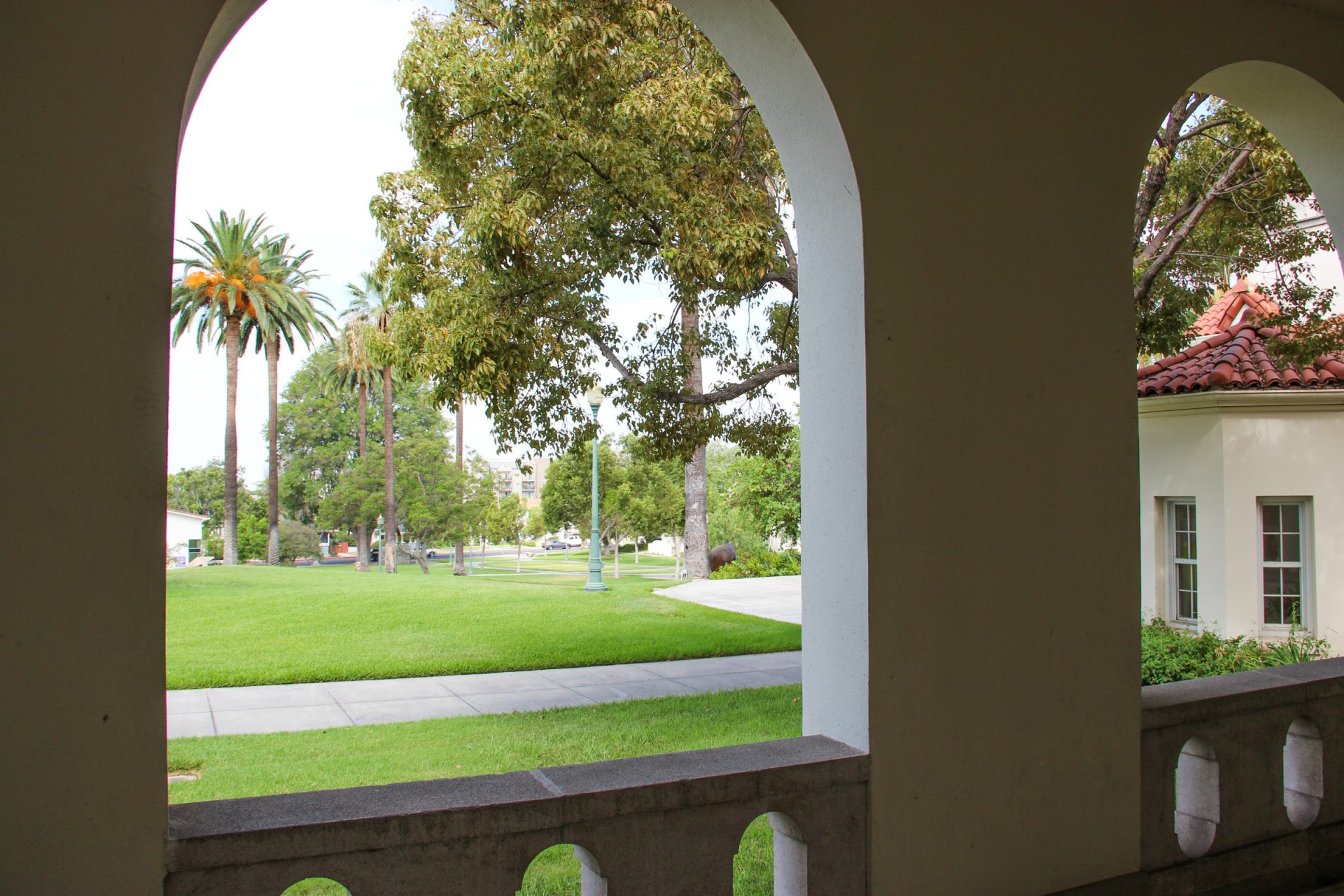 Arch Looking Out at Lawn with Trees