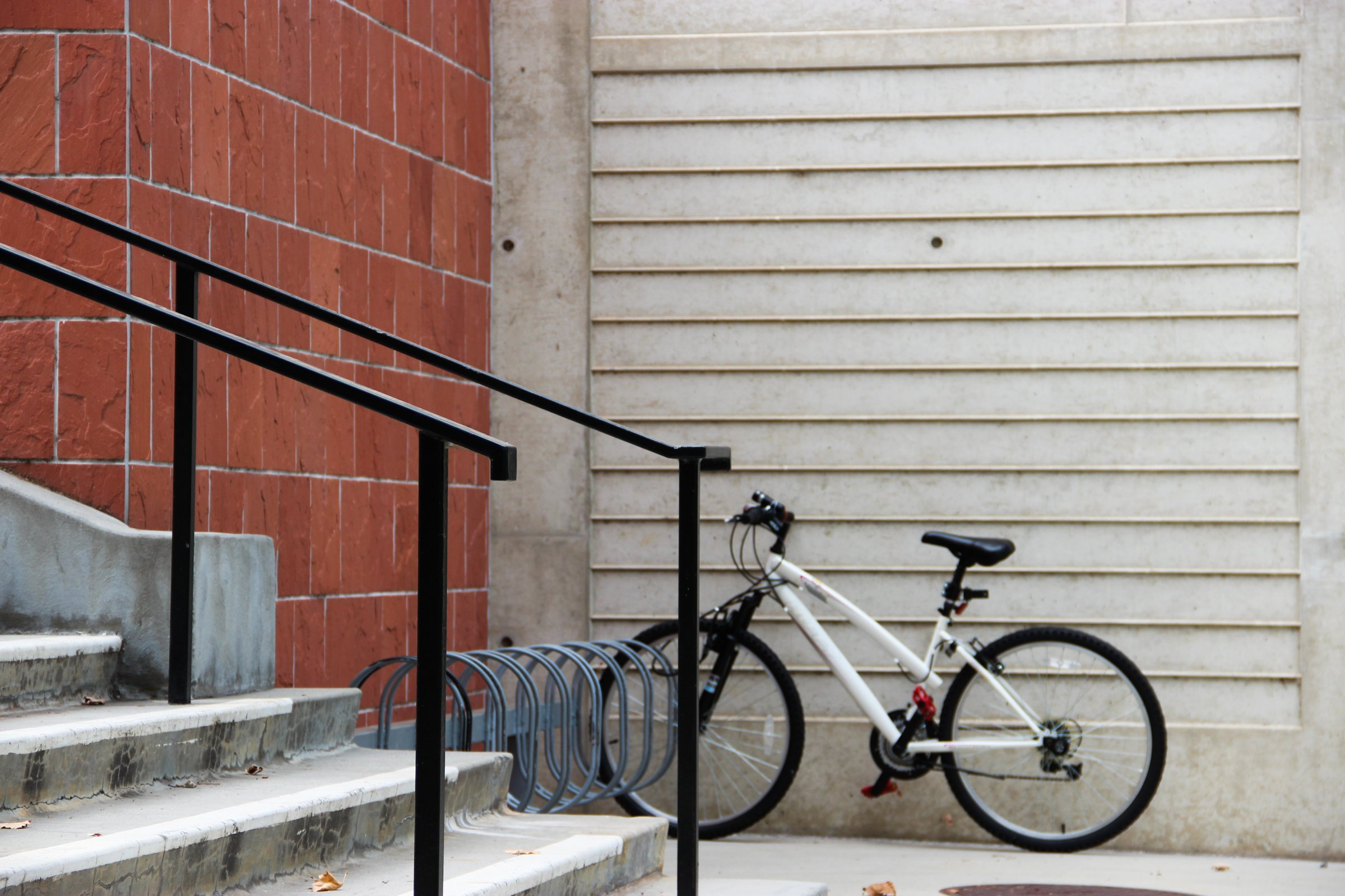 Bicycle Parked by Stairs