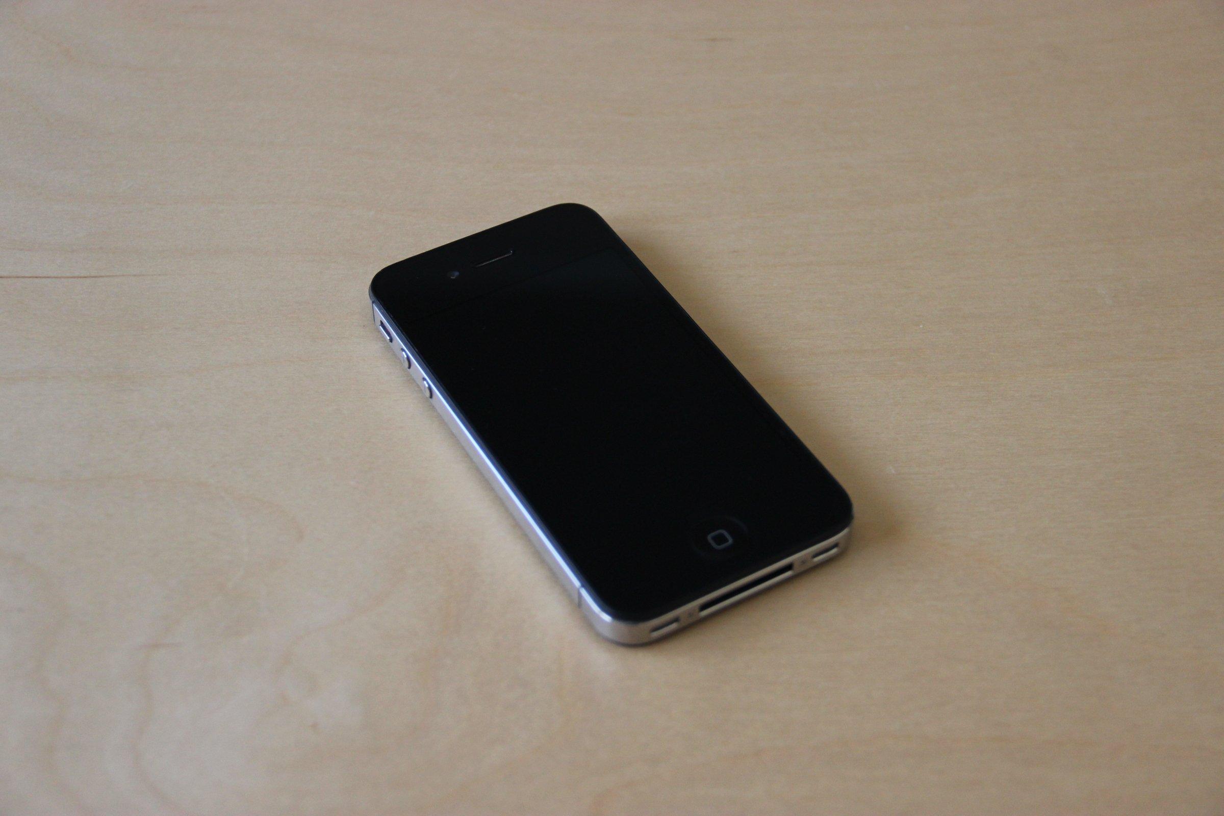Free Stock Photo Of Black Iphone On Light Wood