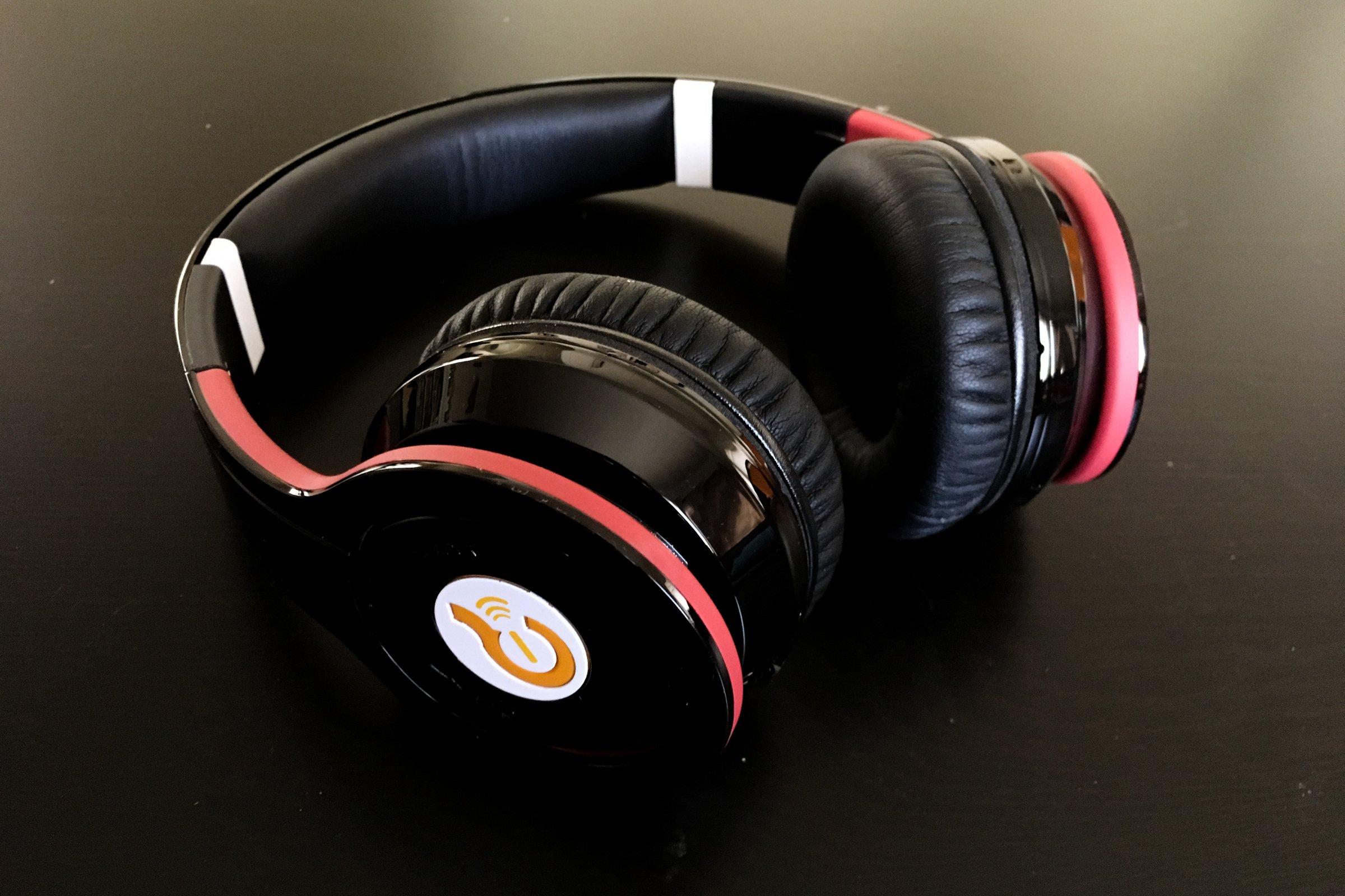 Black & Red Headphones Sitting on Table