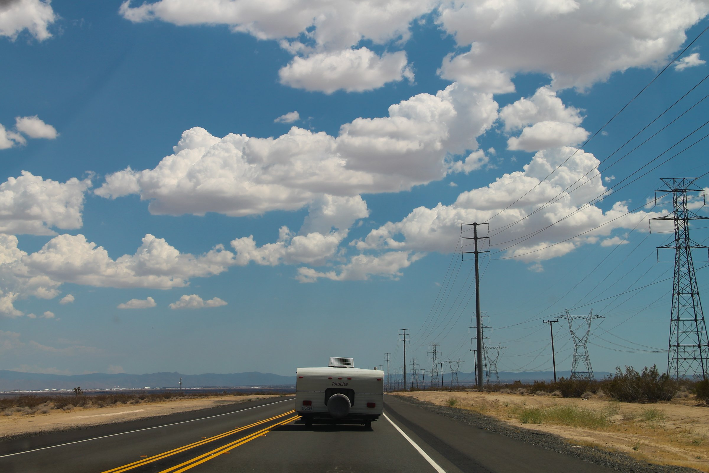 Free Stock Photo of Camper Driving On Desert Road