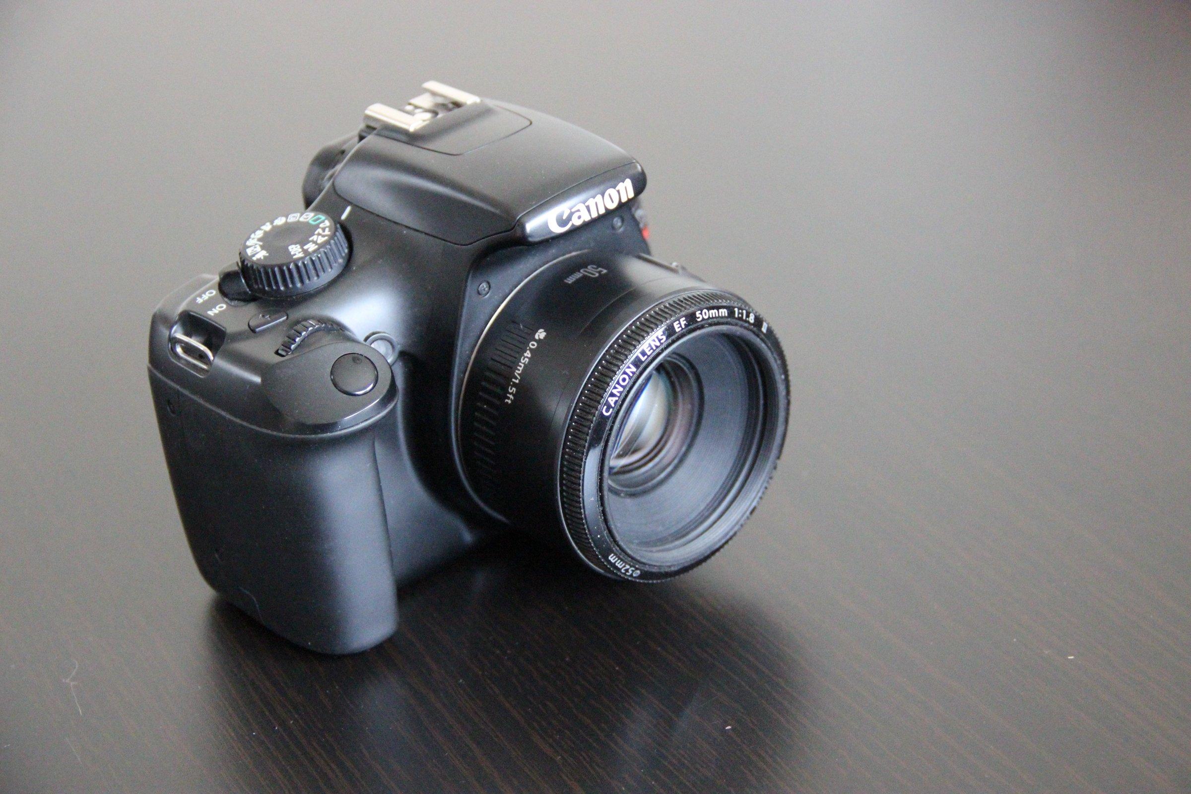 Free Stock Photo of Canon DSLR Camera on Dark Table
