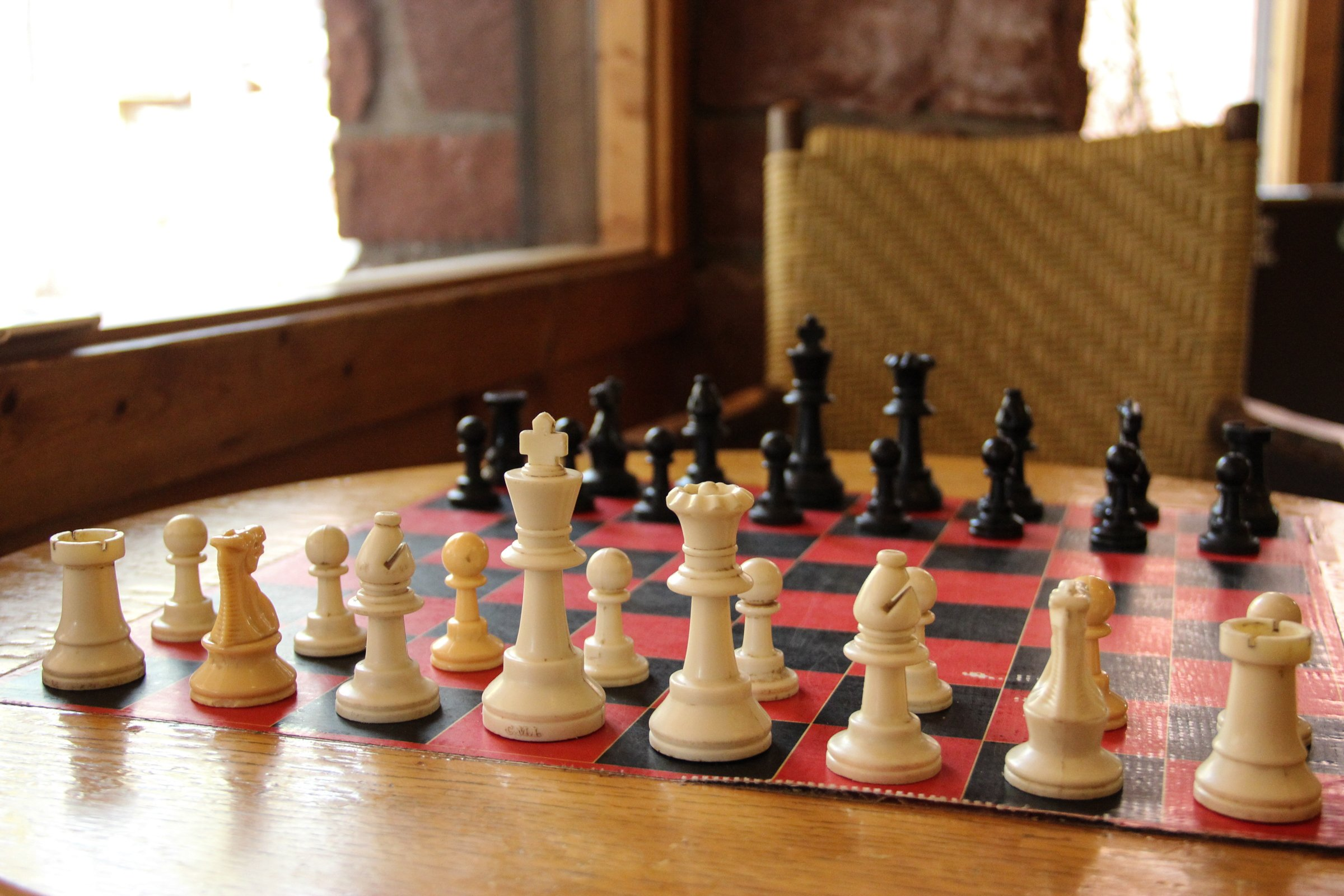 Chess Pieces on Chess Board on Table