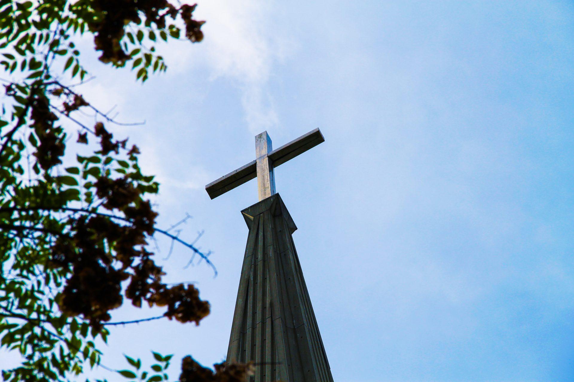 Cross on Church Steeple on Blue Sky