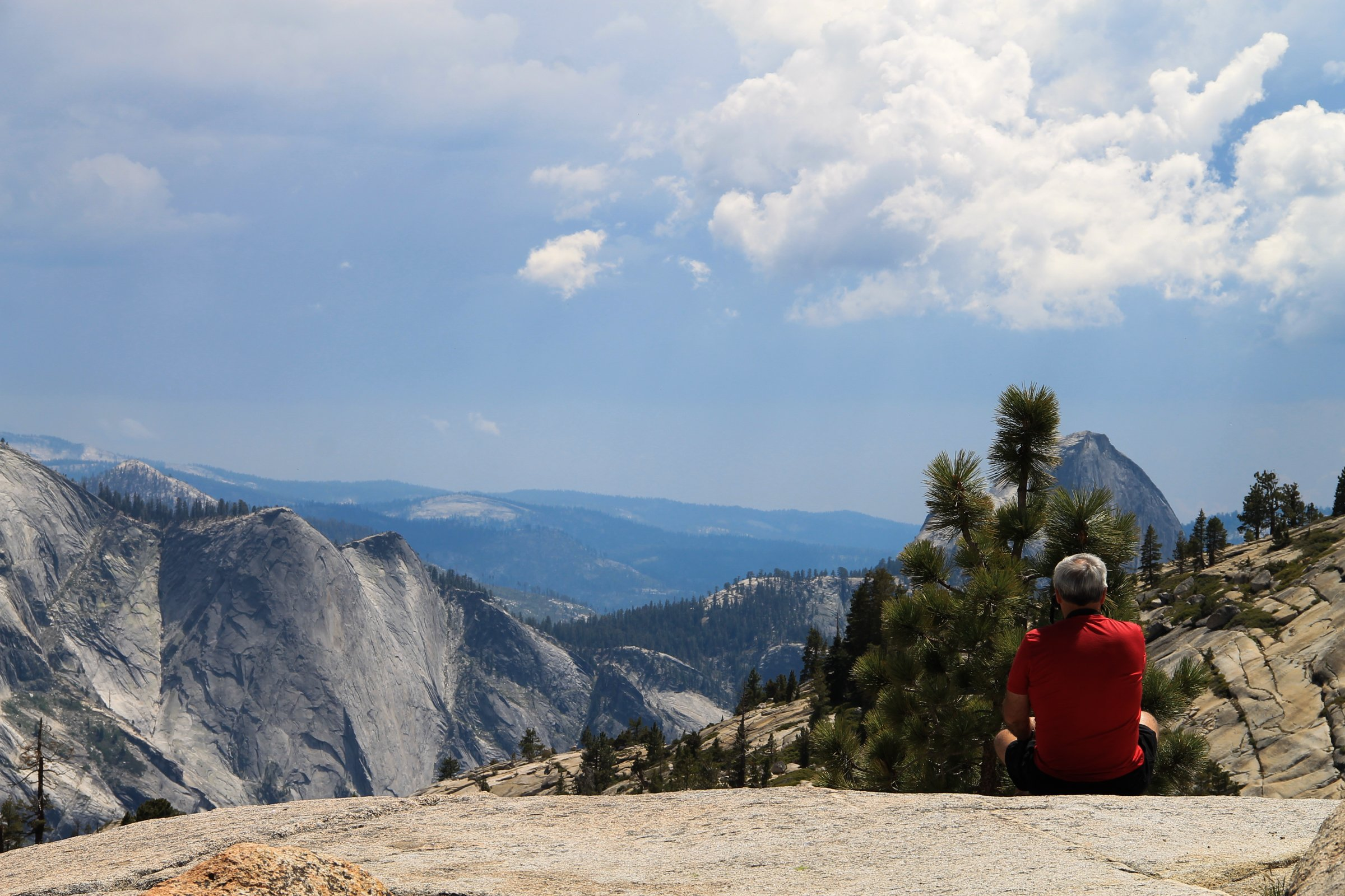Elderly Man Sitting & Looking at Mountains