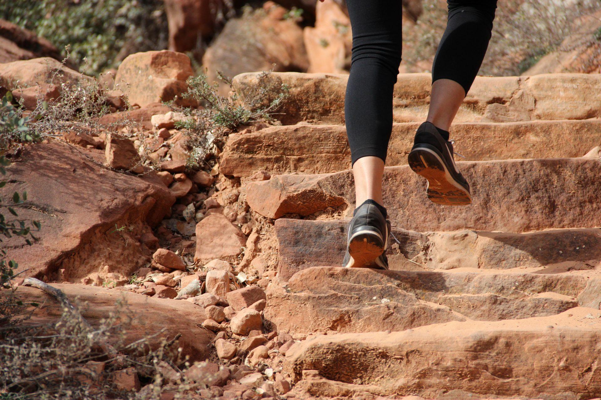 Feet Climbing Up Rock Steps
