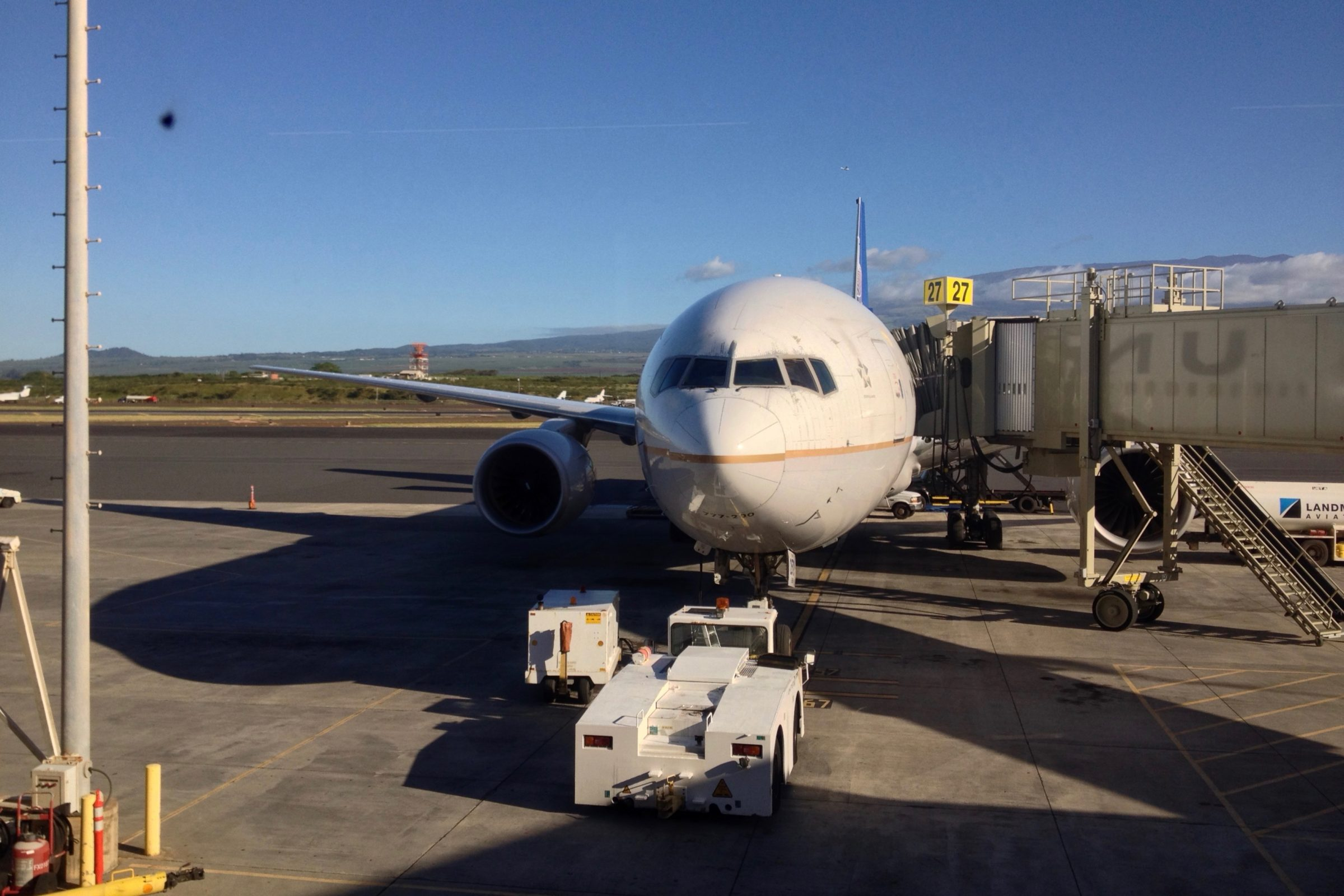 Free Stock Photo of Front of Airplane at Airport Terminal