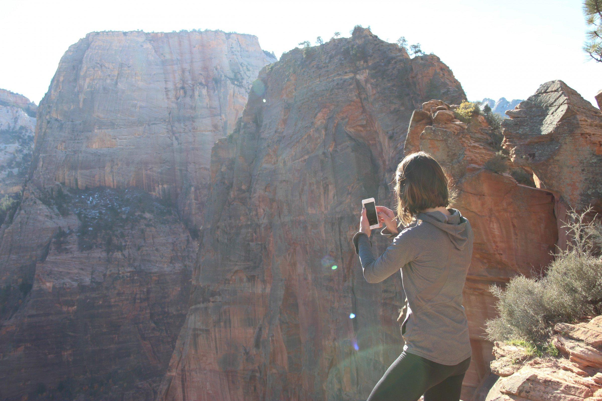 Woman Taking Cell Phone Picture of Mountains