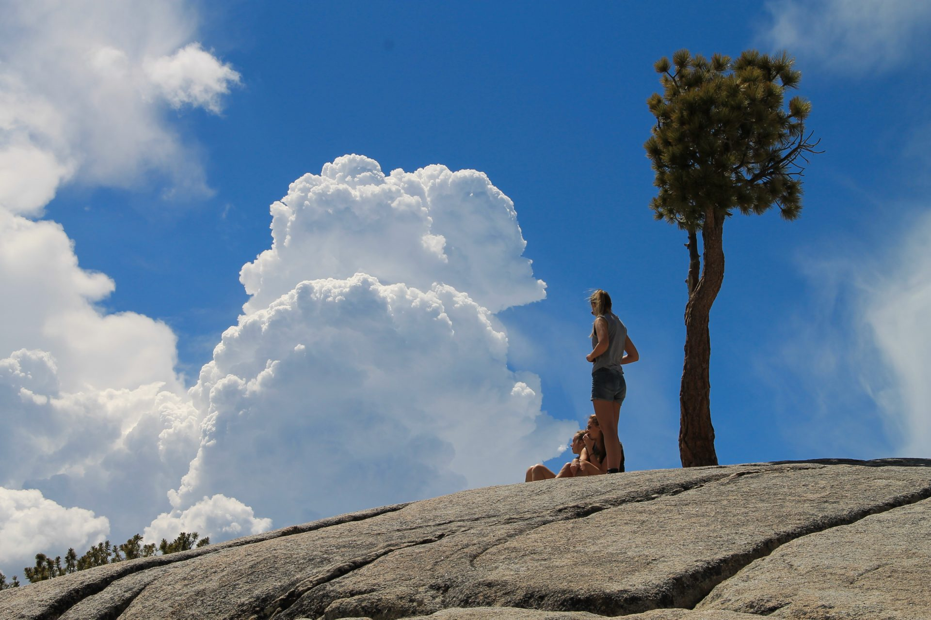Girls on Rock with Clouds