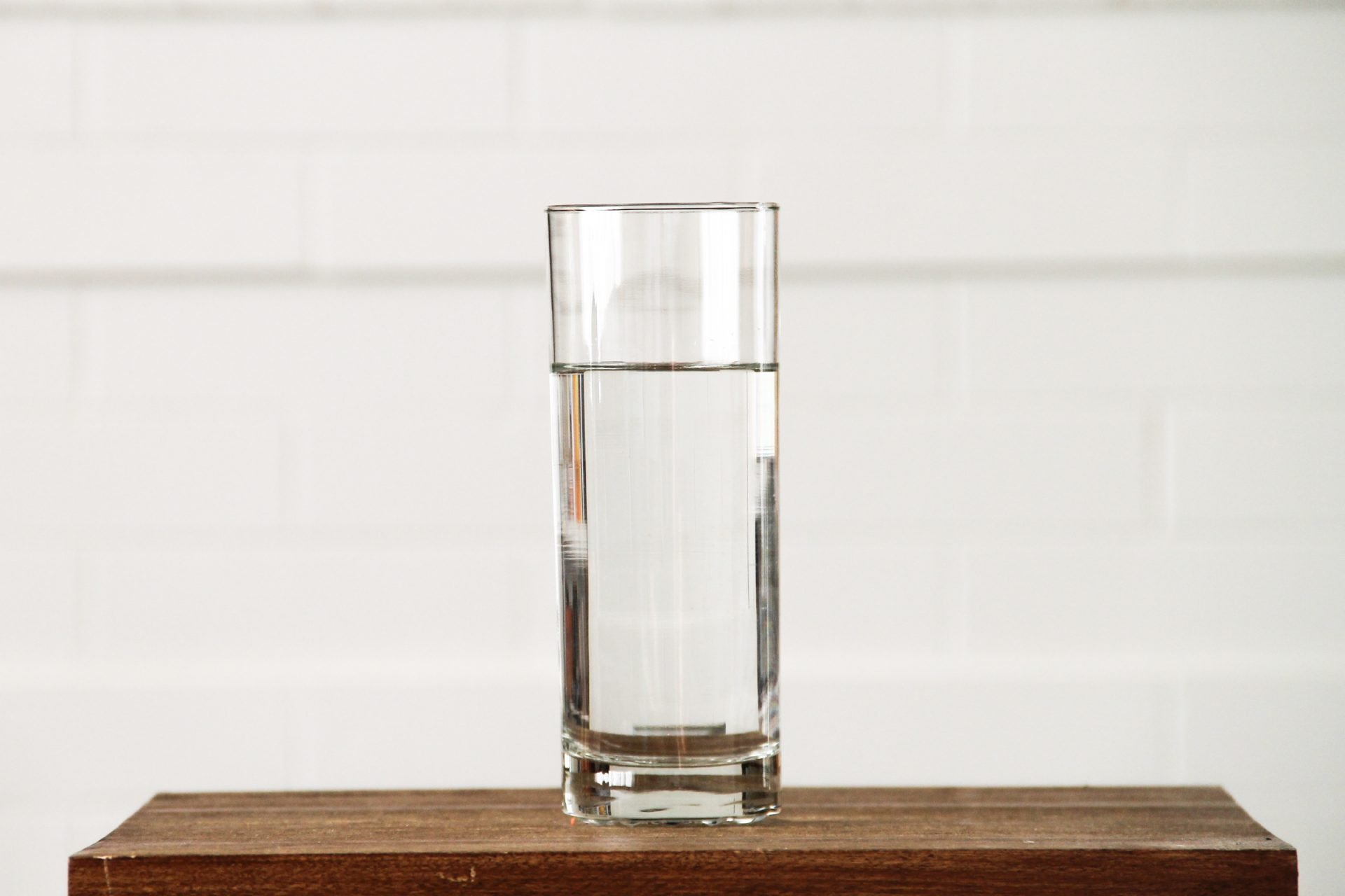 Glass of Clean Water on a Small Table