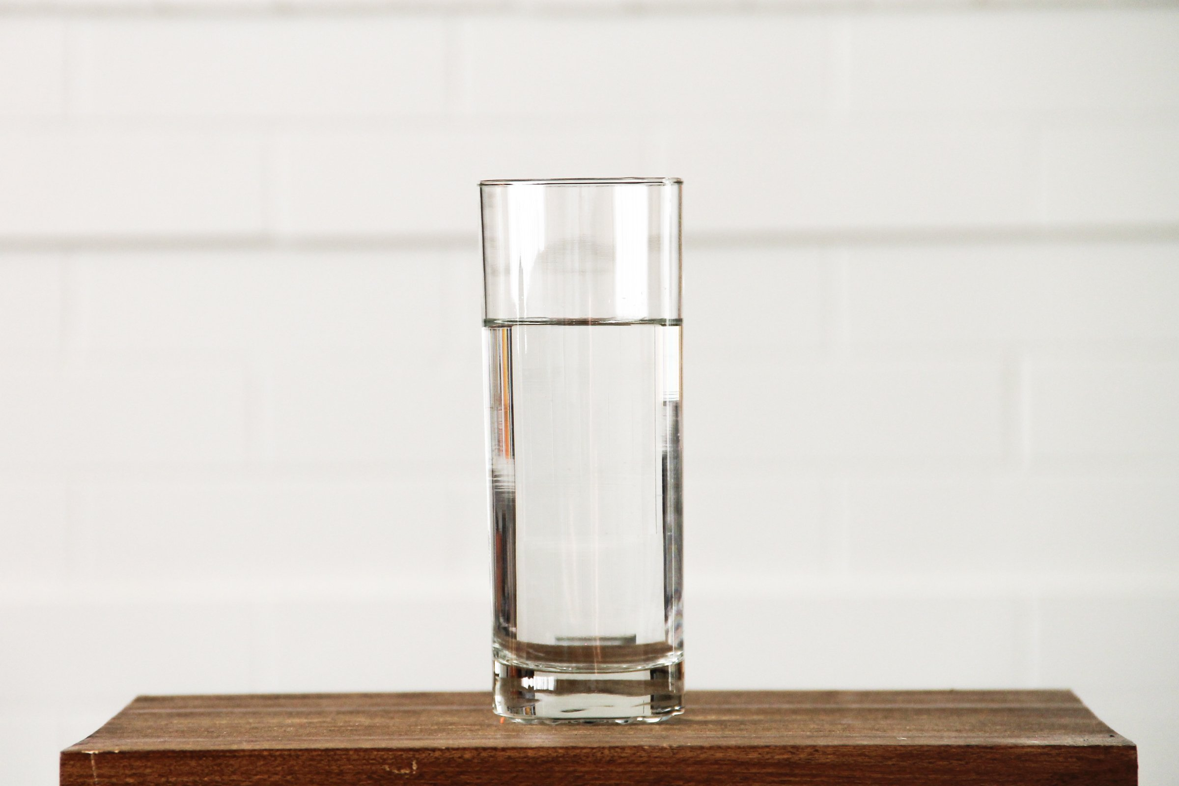 Https Goodstock Photos Glass Of Clean Water On A Small Table