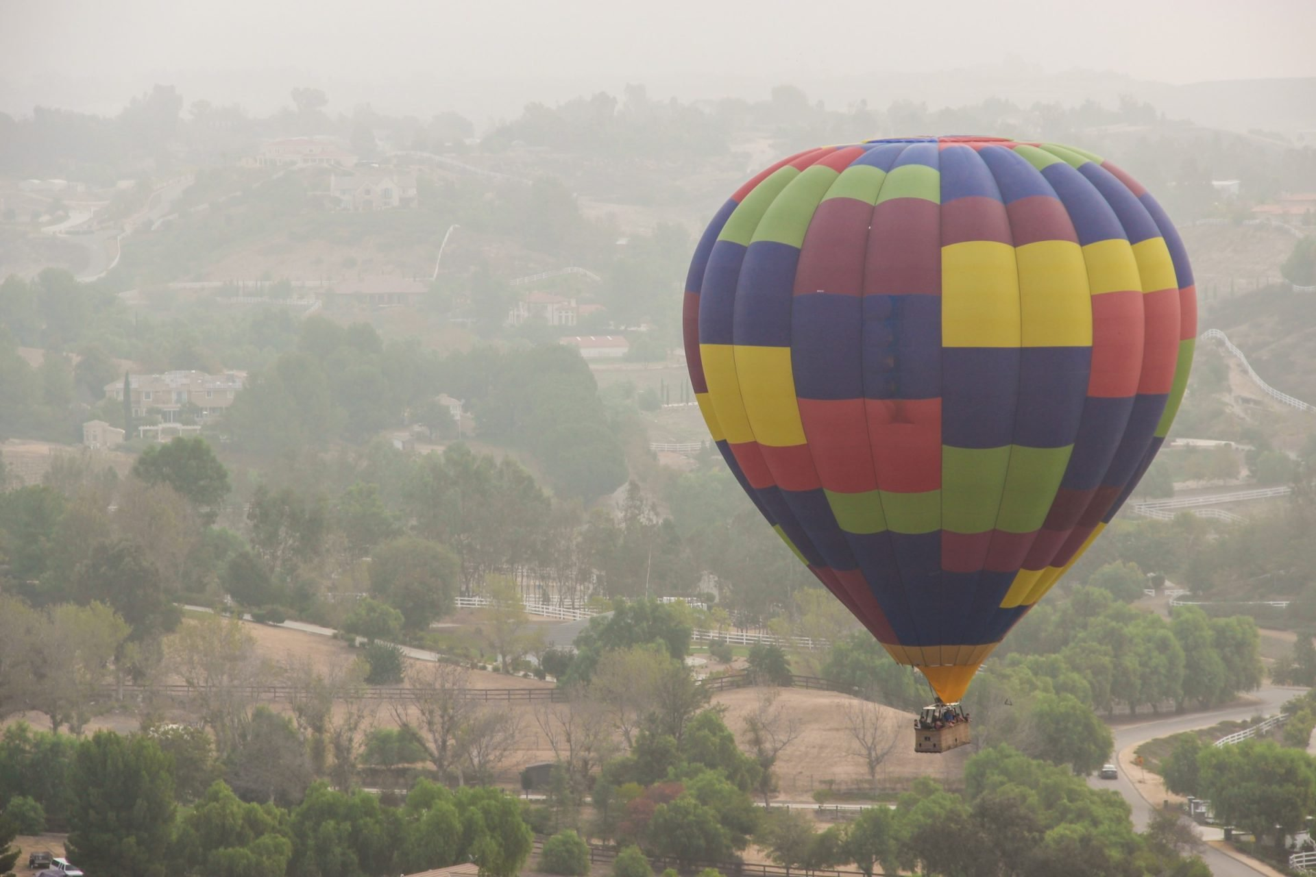 Hot Air Balloon Floating Above Countryside