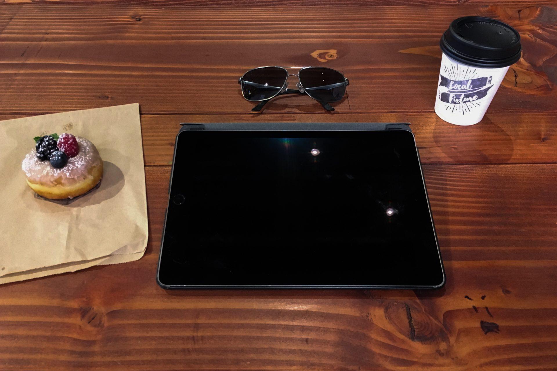 iPad & Coffee on Wood Table