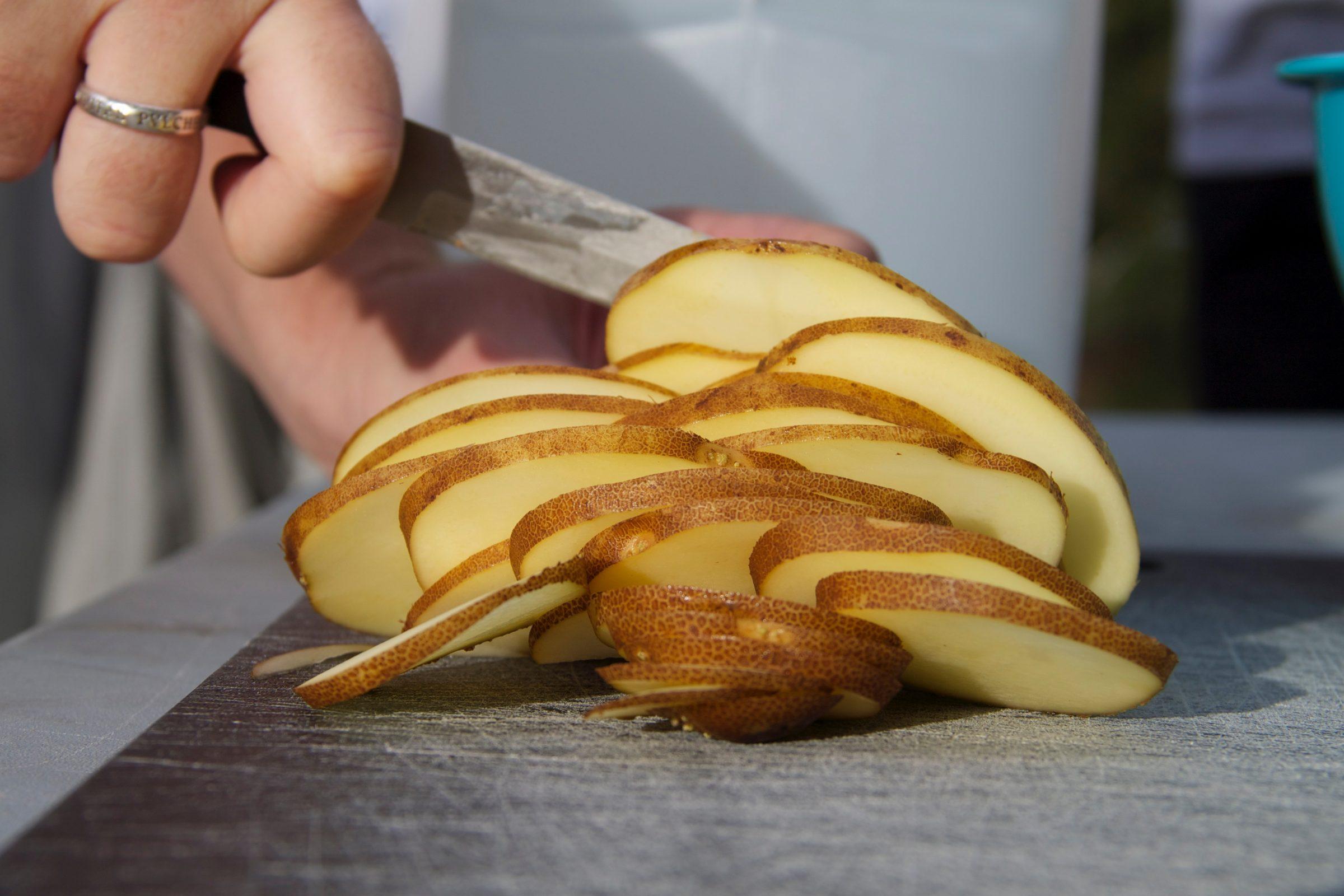 Knife Cutting Potato Slices