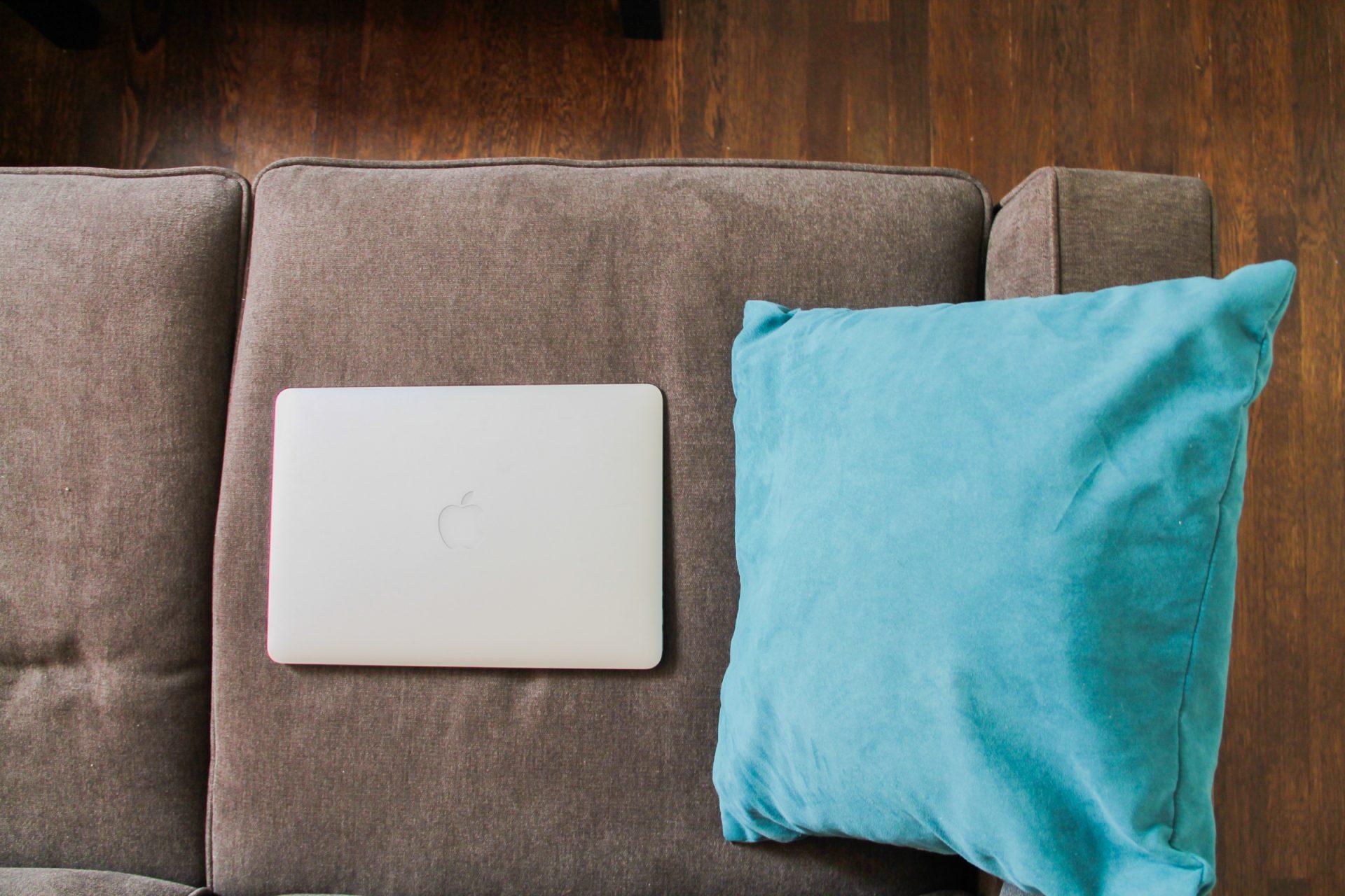 Macbook Laptop on Sofa