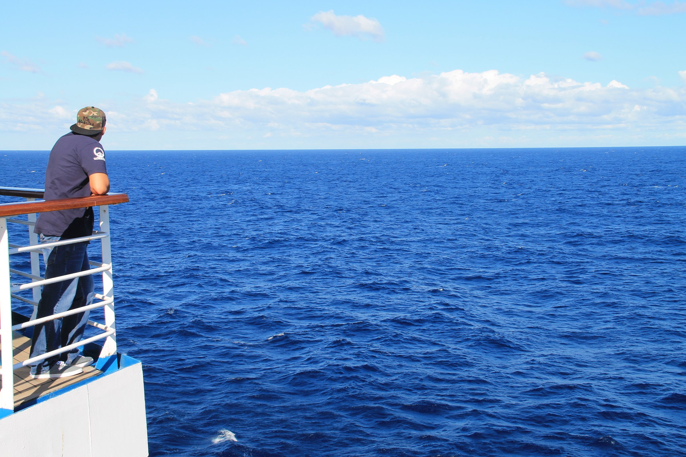 free stock photo of man on deck of cruise ship looking at ocean