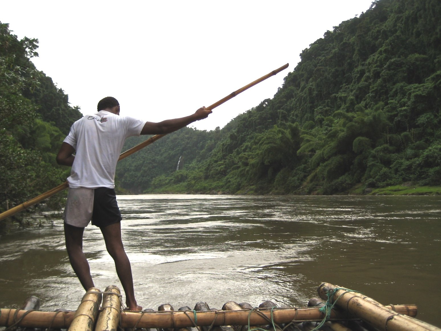 Man with Pole on Raft in River