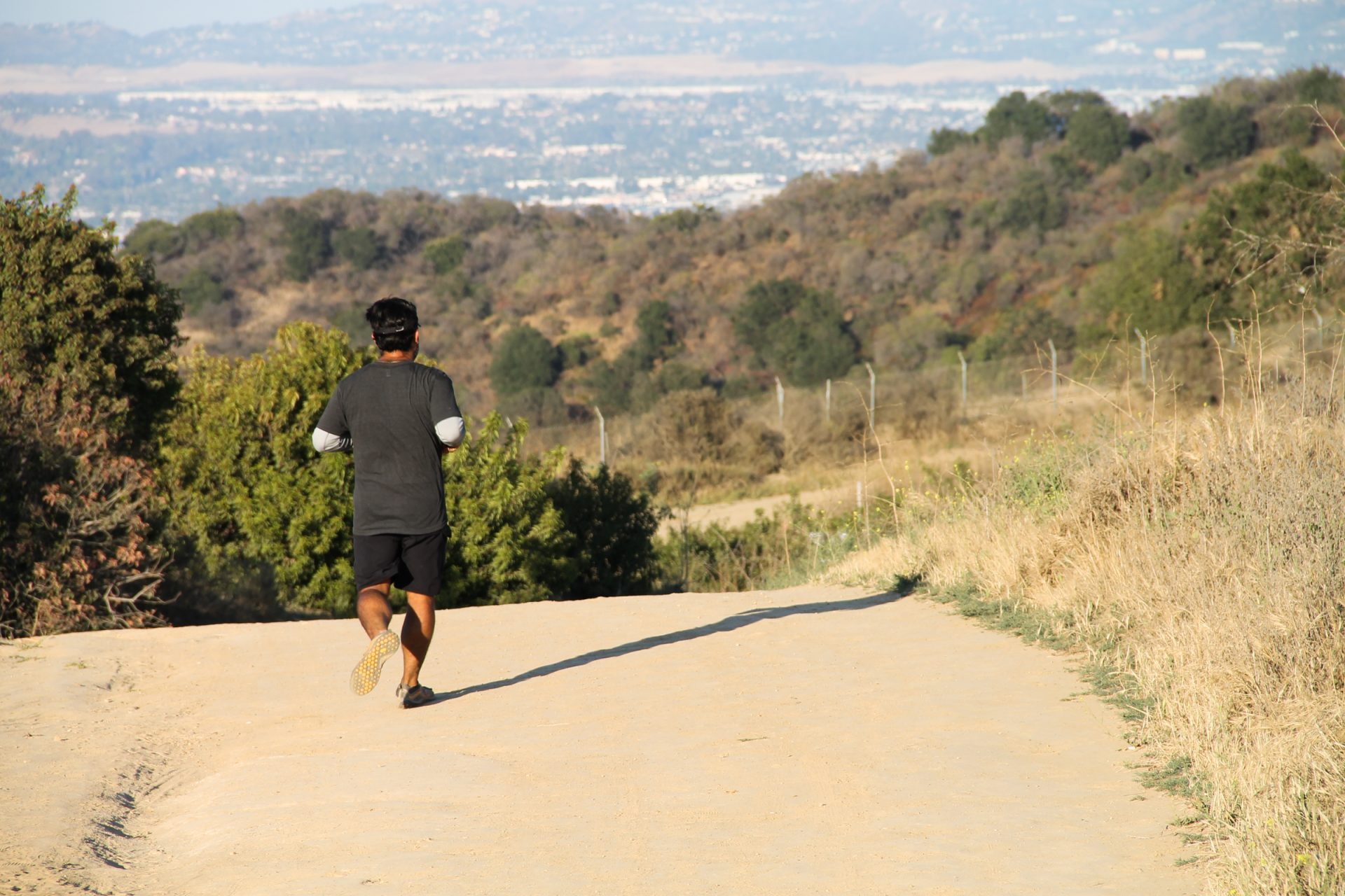Man Running on Dry Dirt Trail