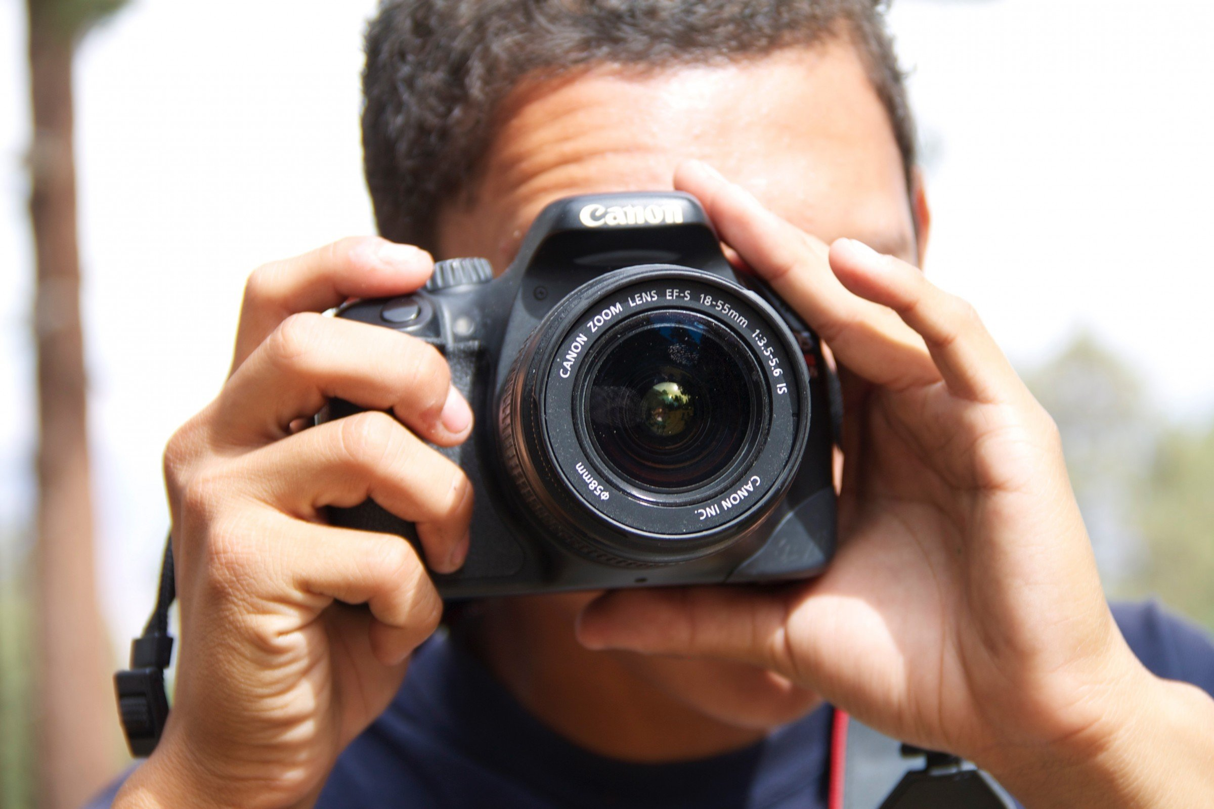 Man's Head Taking Picture with DLSR Camera