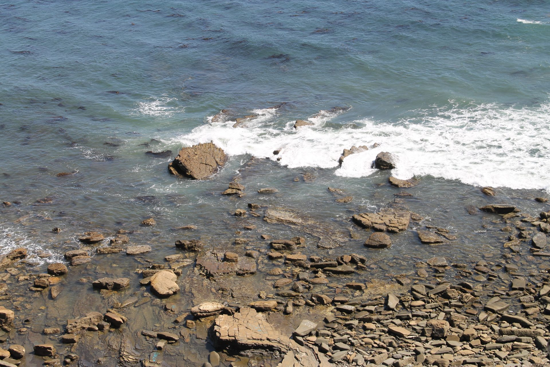 Soft Ocean Waves on Beach Rocks