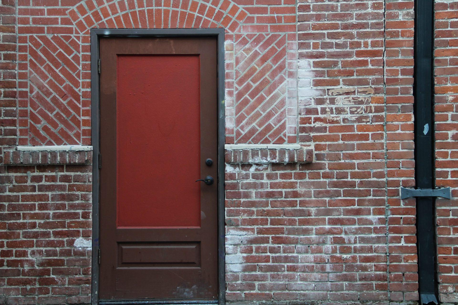 Red & Brown Door on Brick Building