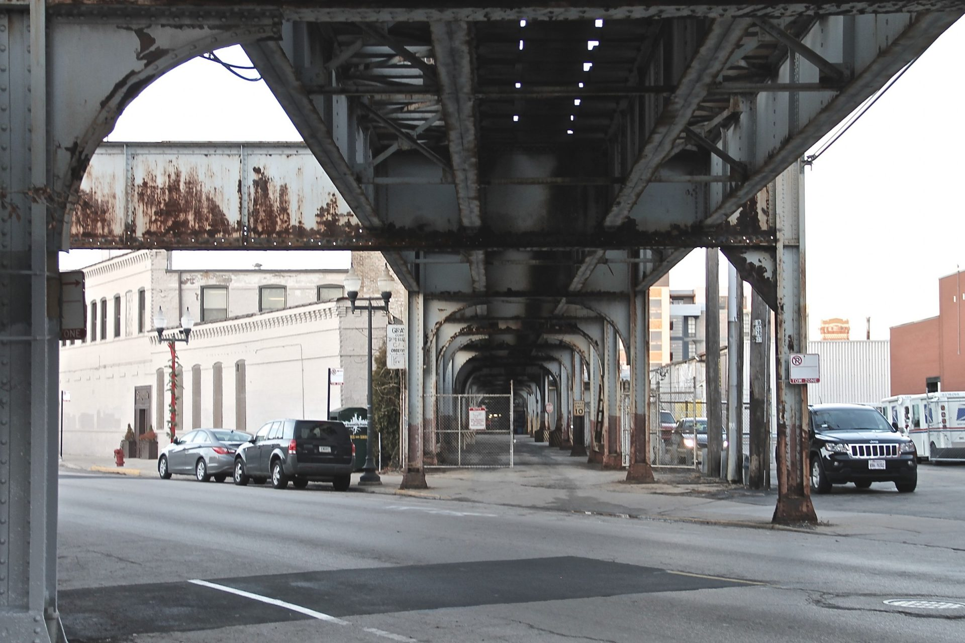 Rusted Metal Bridge Over Street
