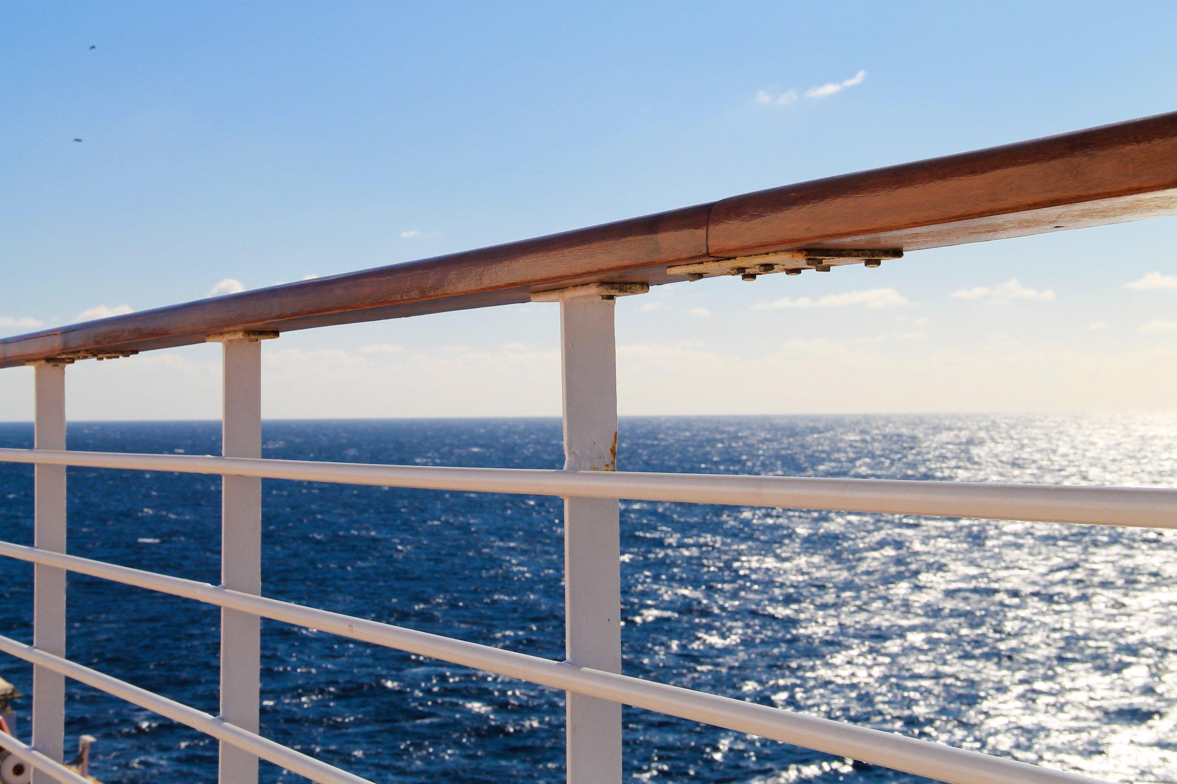 Ship Railing on Open Ocean & Sky