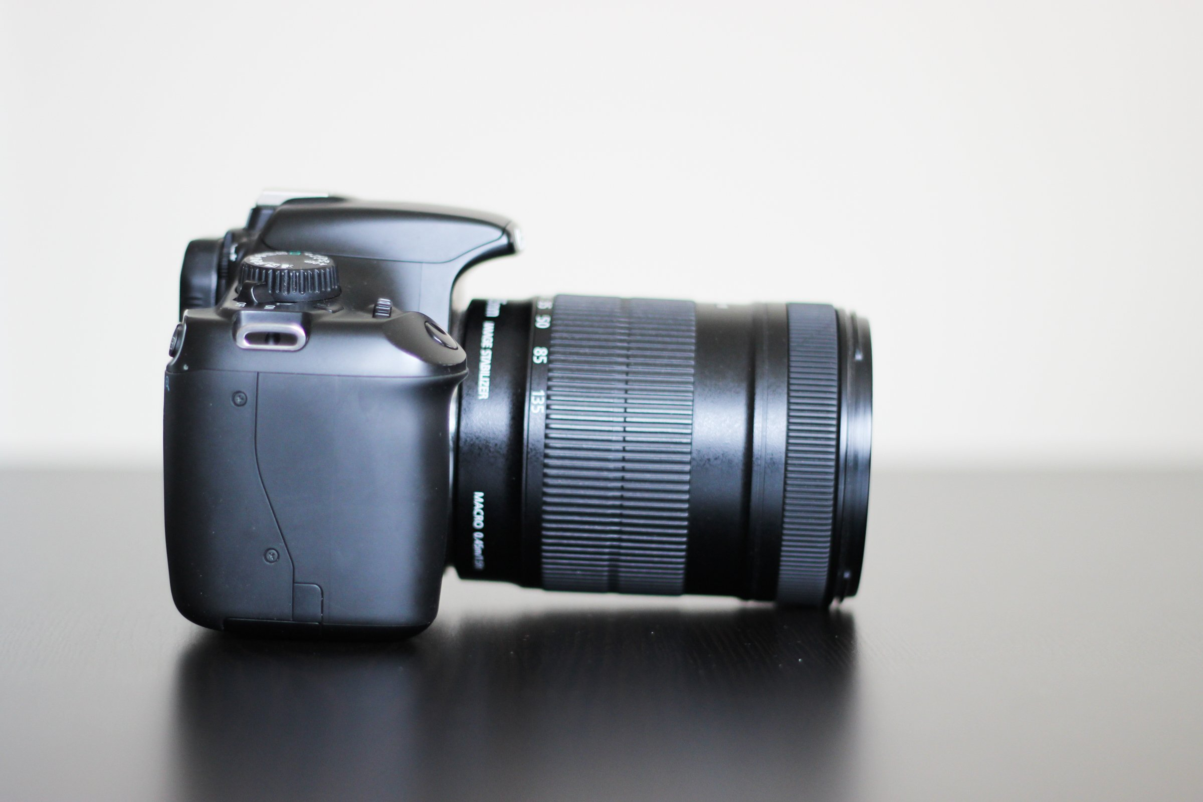 Side View of DSLR Camera with Zoom Lens
