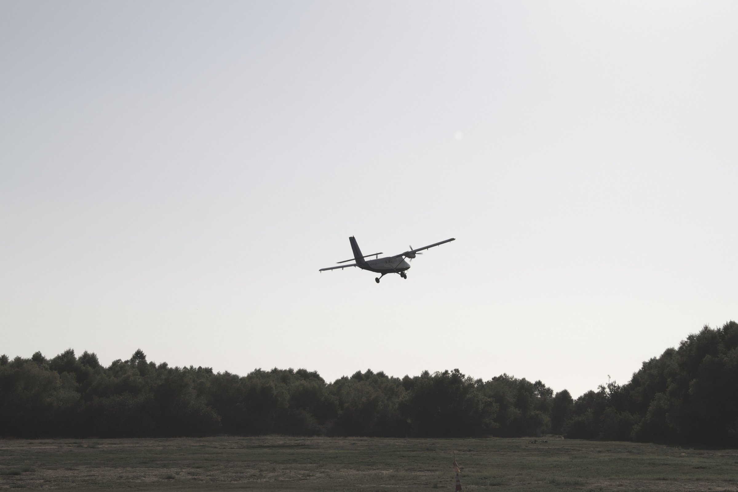 free stock photo of small airplane taking off into distance