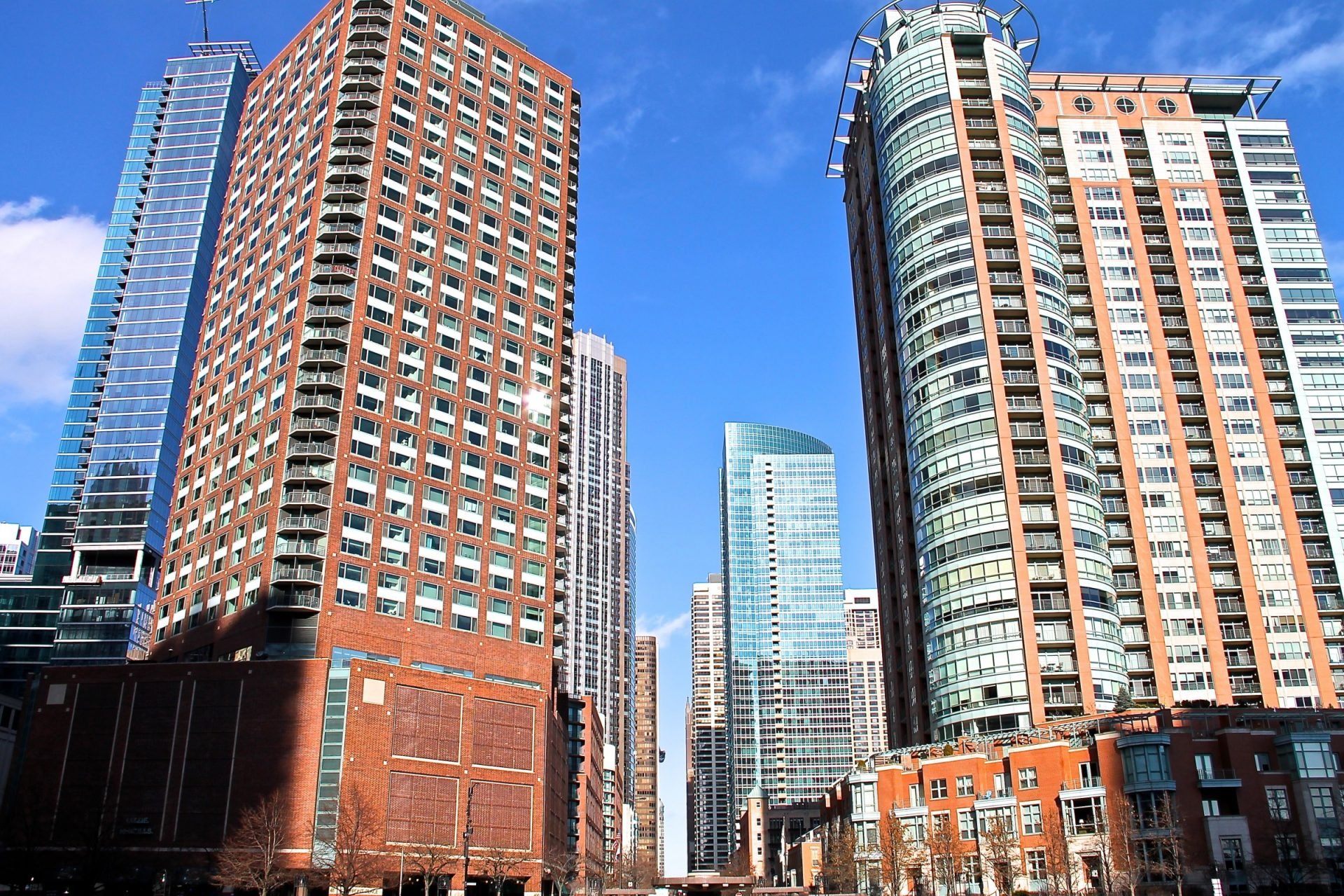 Tall Brick & Glass Buildings in City