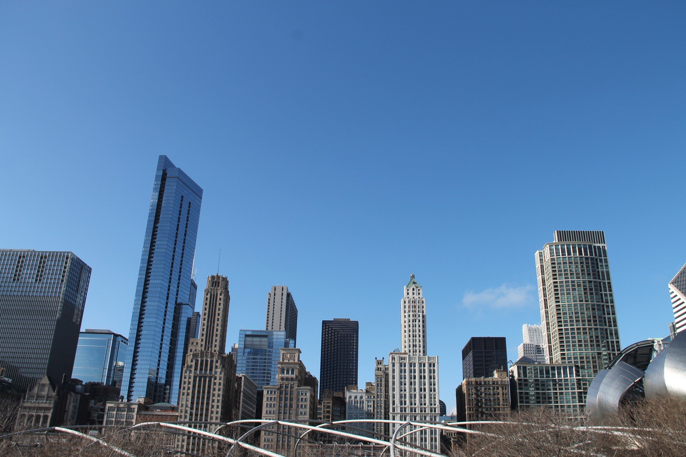 Free Stock Photo of Tall Buildings of City Skyline Against Clear Sky