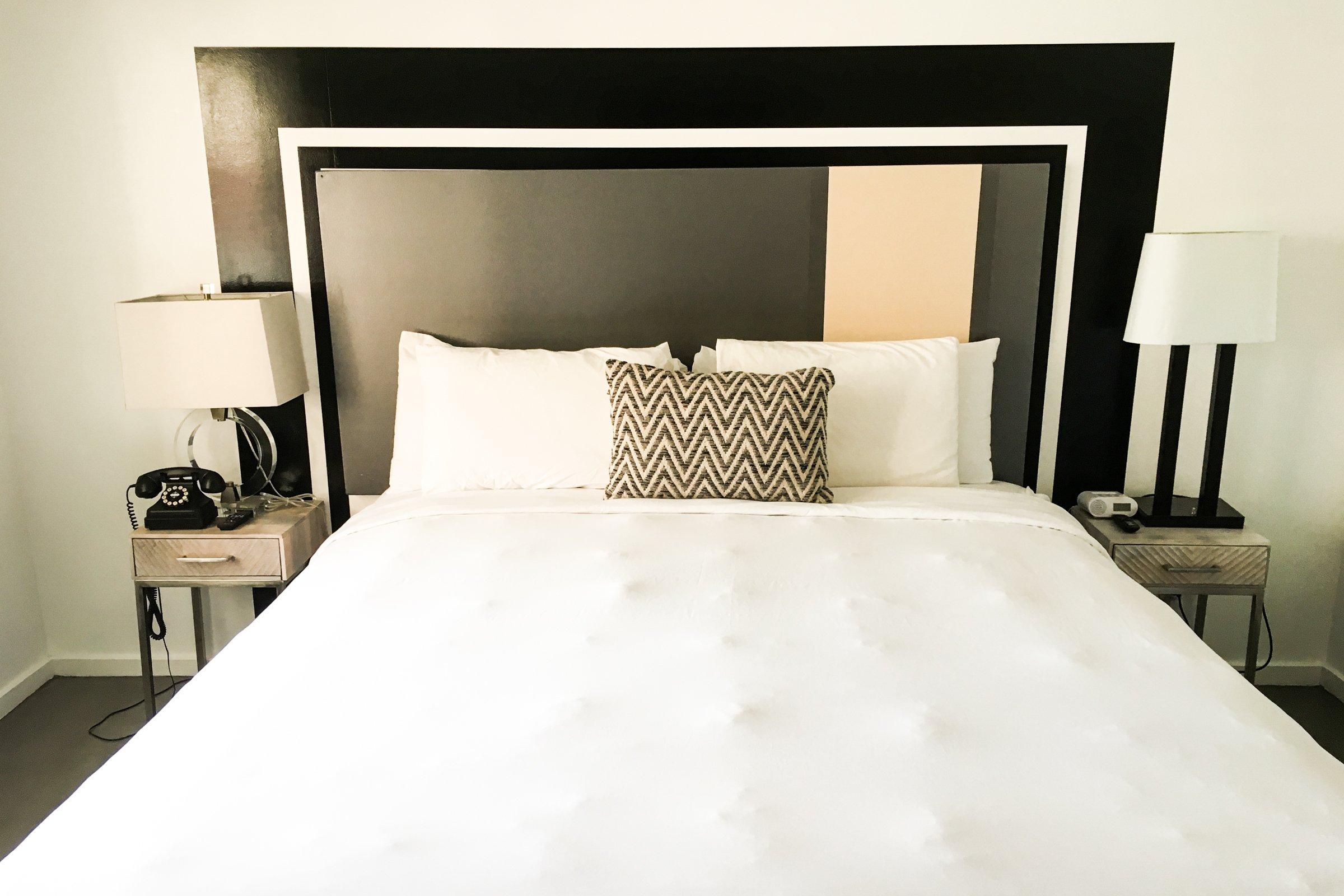 White Bed in Black & White Hotel Bedroom