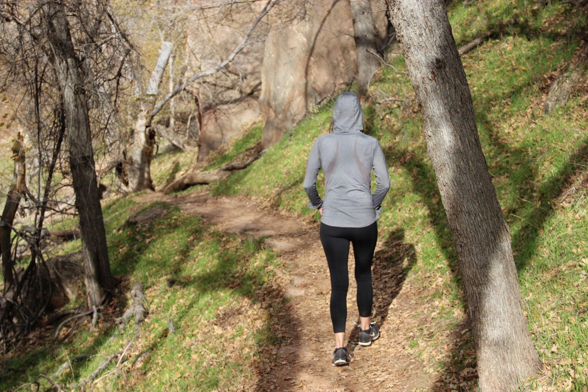 Woman in Hoodie & Yoga Pants Walking in Nature
