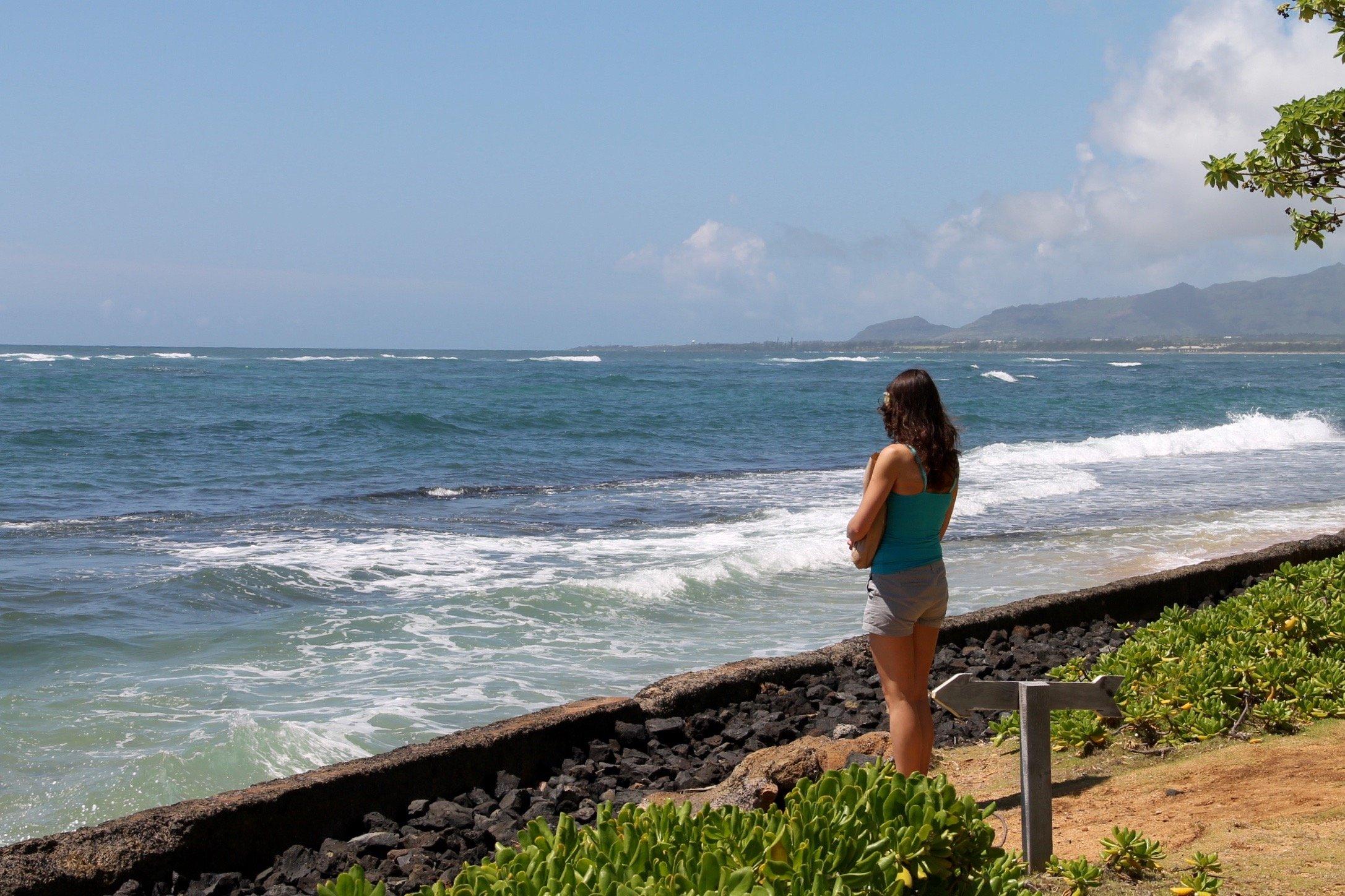 Woman Standing at Shore of Ocean